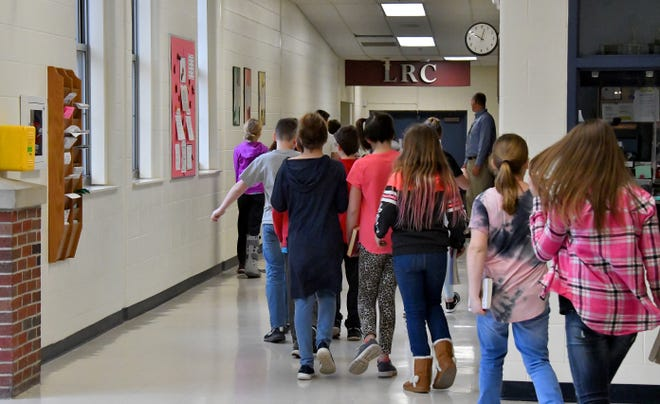 Students make their way down a hallway at Marshall Middle School in Marshall, Michigan, where security improvements are being funded with a grant from the Michigan State Police.