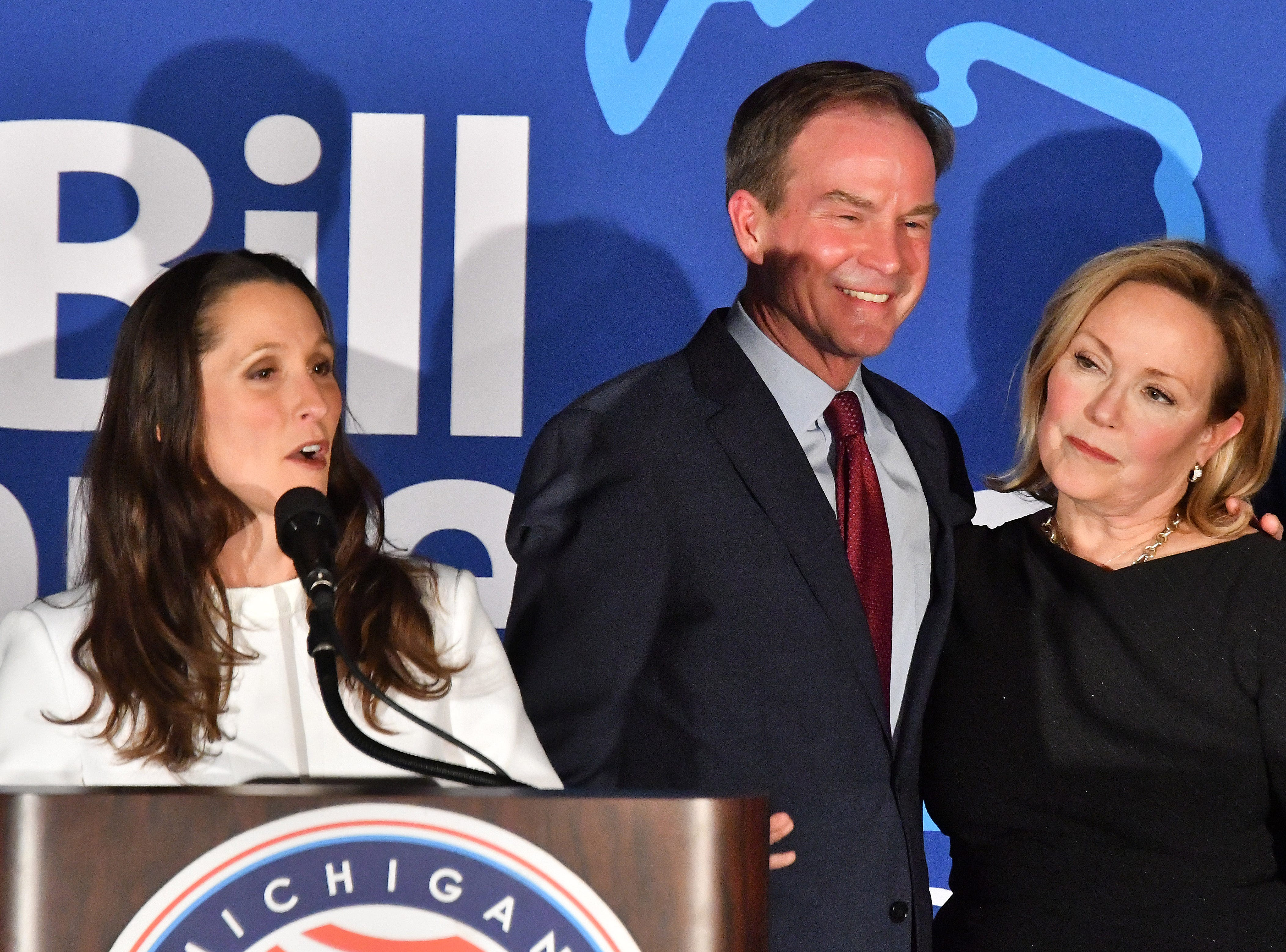 Lt. governor candidate Lisa Posthumus Lyons addresses the crowd beside running mate Bill Schuette and his wife Cynthia as the Michigan GOP gathers at the Lansing Center.