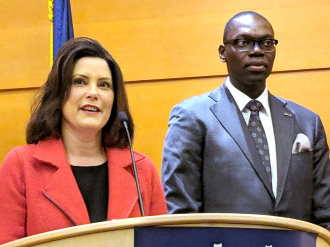 Michigan Governor-elect Gretchen Whitmer and her Lt. Gov. Garlin Gilchrist take questions from the media during a press conference at the Motor City Casino Hotel in Detroit  on Wednesday.