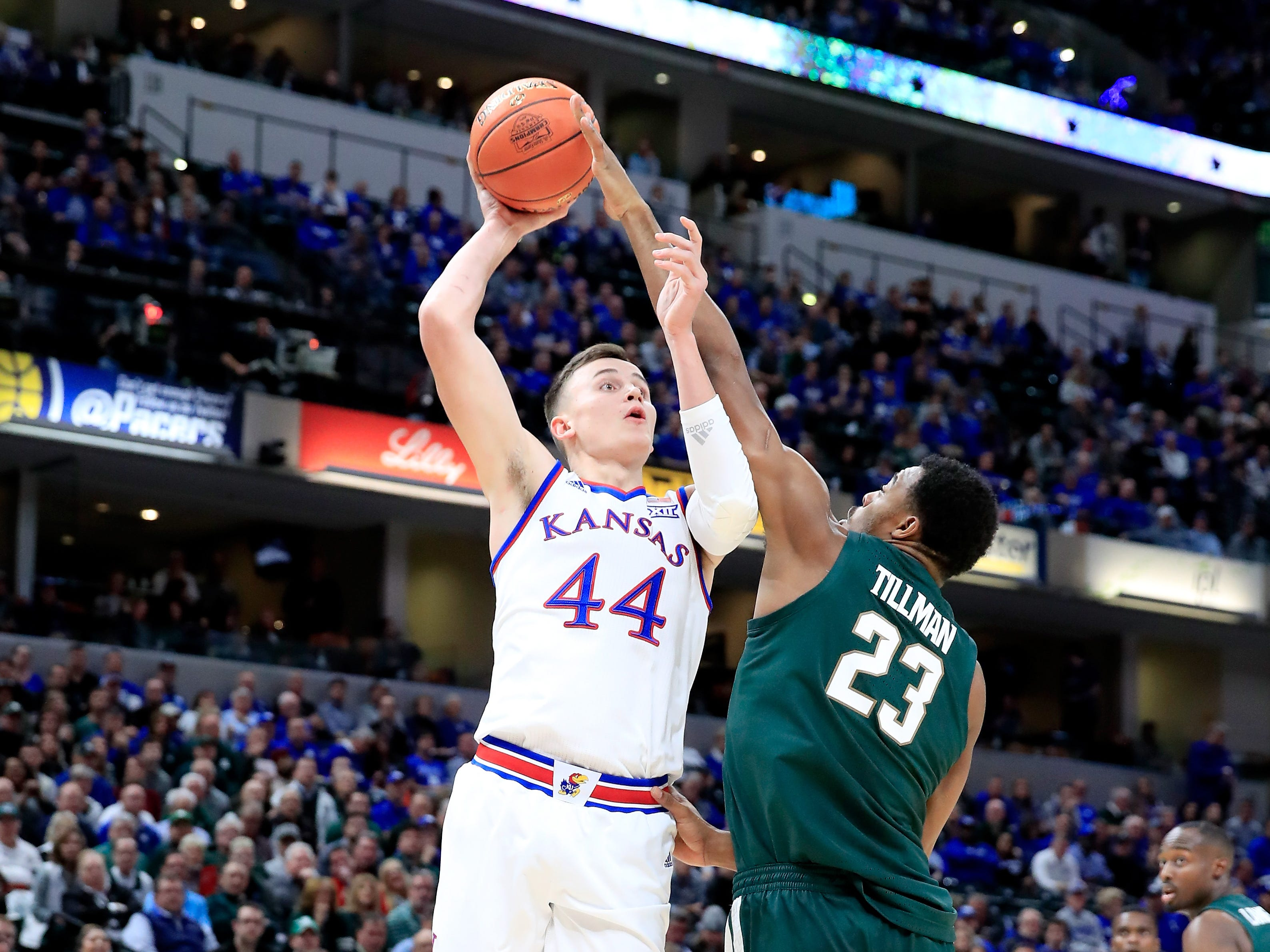Mitch Lightfoot (44) of the Kansas Jayhawks shoots the ball against the Michigan State Spartans during the State Farm Champions Classic.