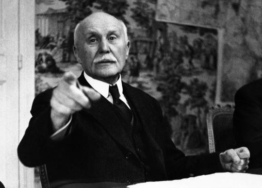 This June 9, 1941 file photo shows France's Marshal Philippe Petain pointing as he ordered the AP photographer from the room during the sell-out meeting of the Council of Ministers in Vichy, central France.