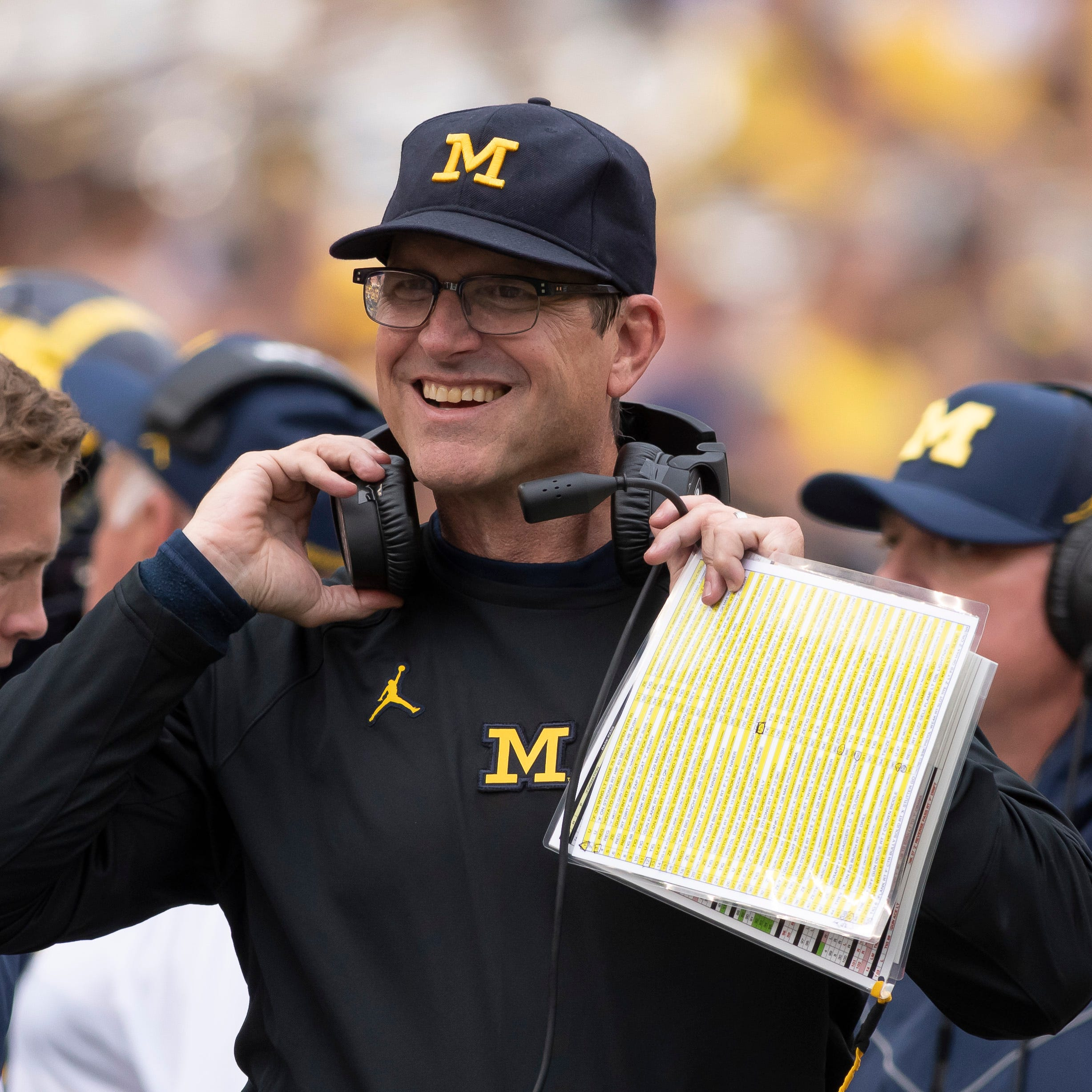 UM's Manuel shoots down rumors: Harbaugh 'will end his career here'