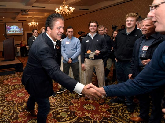 Rep. Mike Bishop, R-Mich., left, shakes hands at his campaign watch party with supporter Tommy Saracino in Rochester, Tuesday.