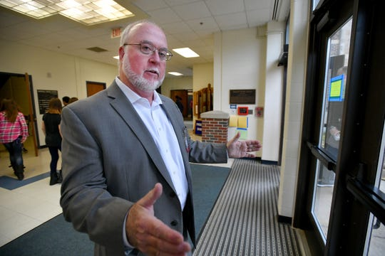 Randall Davis, superintendent of schools in Marshall, explains where a new security vestibule will be constructed at the Marshall Middle School. Security improvements are being funded with a grant from the Michigan State Police.
