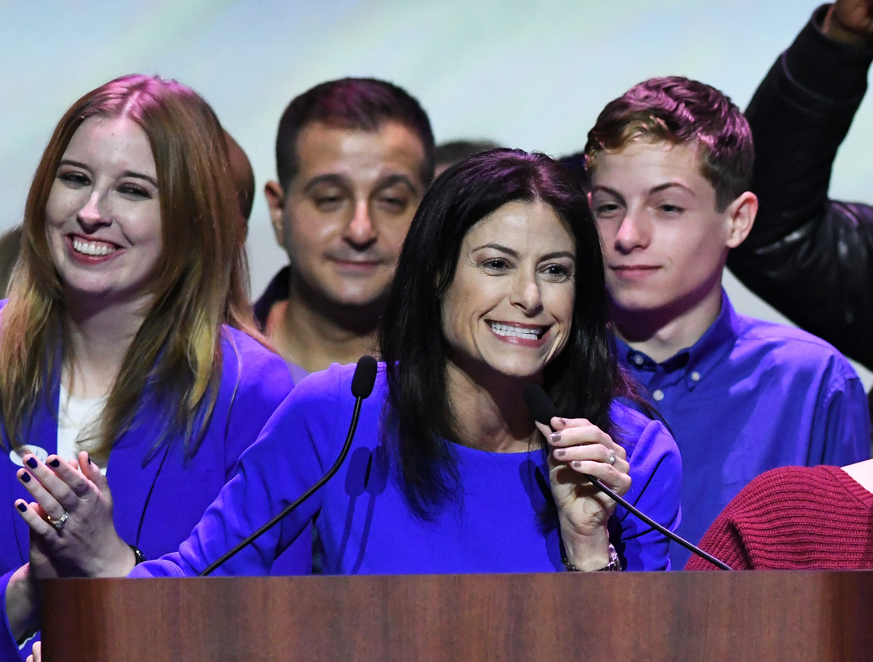 Michigan Attorney General candidate Dana Nessel thanks supporters at the Democrats' election night party in Detroit. At left is her wife,  Alanna Maguire