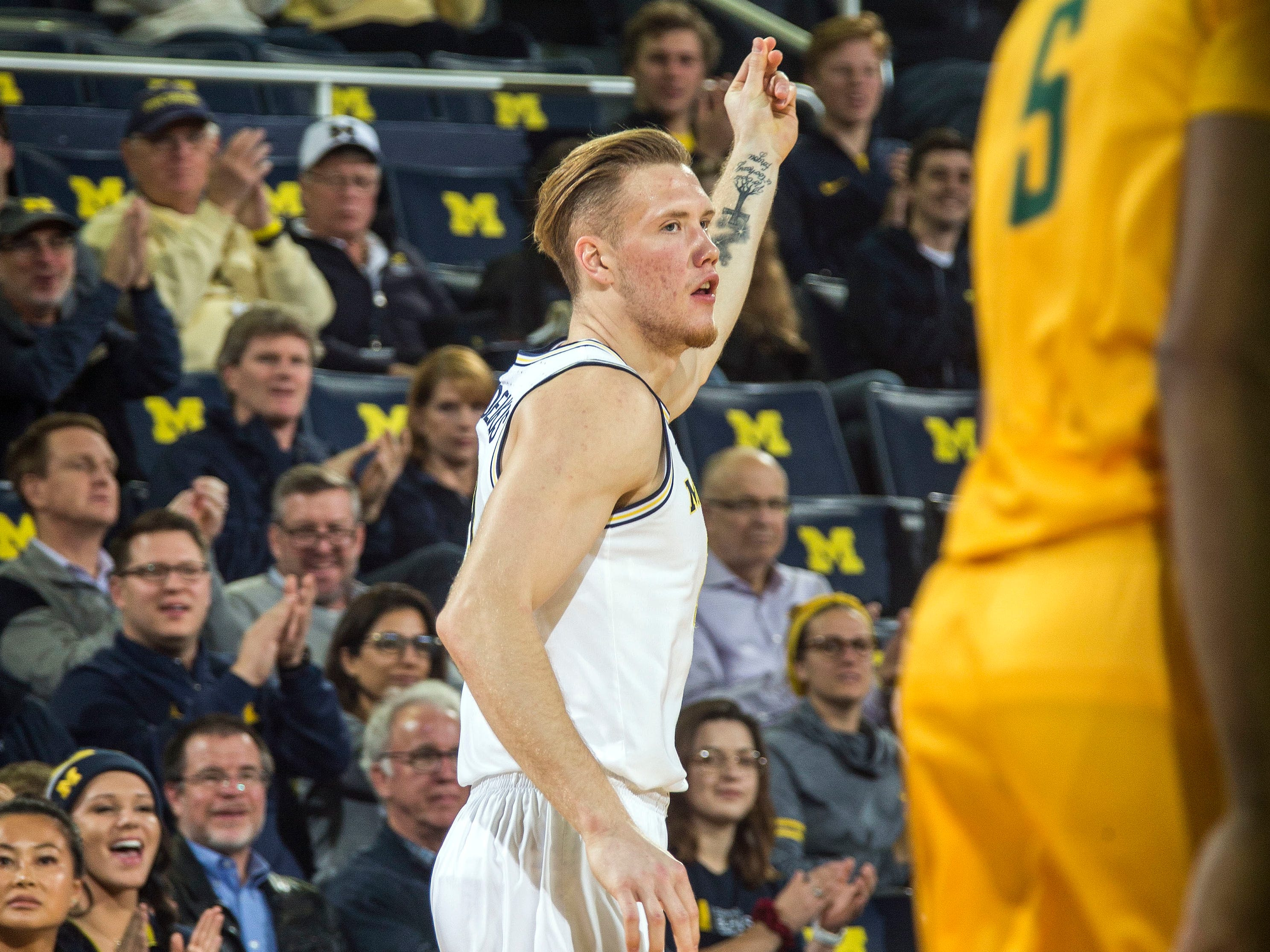 Michigan forward Ignas Brazdeikis celebrates making a three point basket in the first half of an NCAA college basketball game against Norfolk State