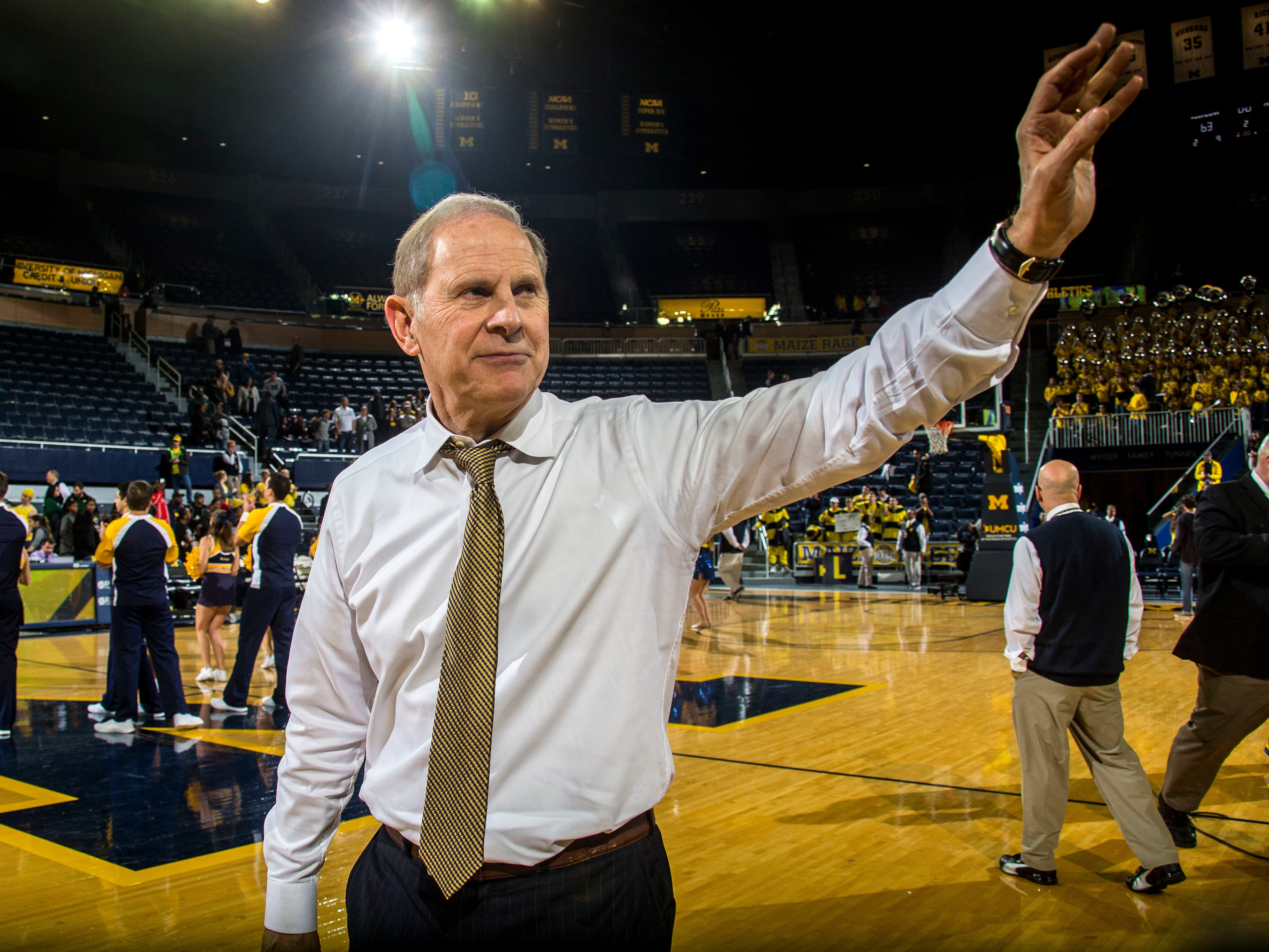 Michigan head coach John Beilein waves to fans after an NCAA college basketball game against Norfolk State at Crisler Center in Ann Arbor, Mich., Tuesday, Nov. 6, 2018. Michigan won 63-44, and Beilein won his 800th career game as a coach.