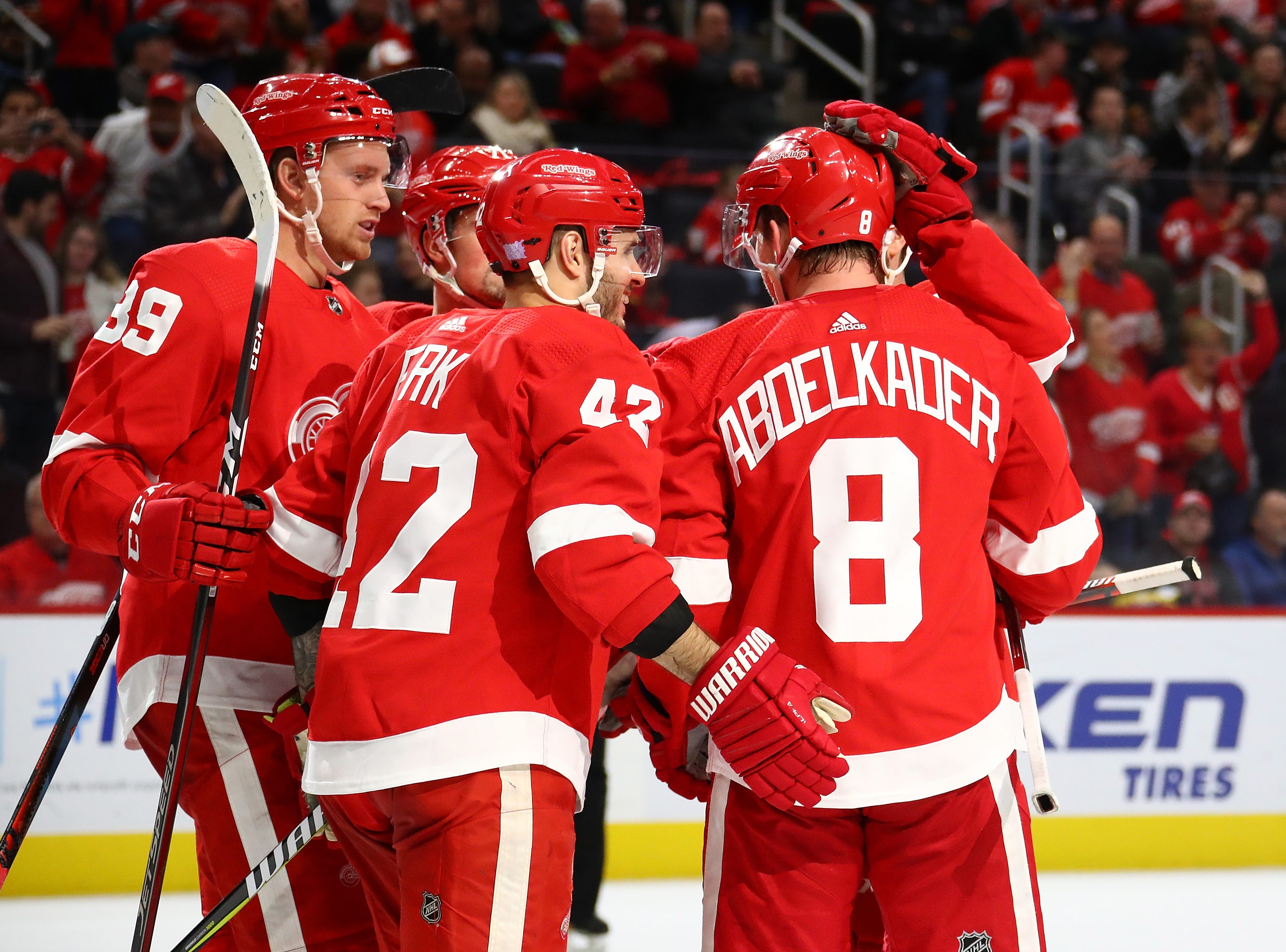 Justin Abdelkader (8) of the Detroit Red Wings celebrates his second period goal with teammates while playing the Vancouver Canucks at Little Caesars Arena.
