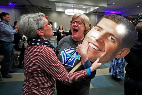 Supporters of Rep. Conor Lamb, D-Pa, Joanie Foran, left, and Linda Bishop, of Progress, Pa., begin to celebrate after hearing CNN projected Lamb the winner in Pennsylvania's 17th Congressional District, at his election night party in Cranberry, Pa.