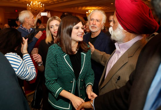 Haley Stevens, candidate for Michigan's 11th Congressional District seat,  greets supporters at an election night party in Birmingham.