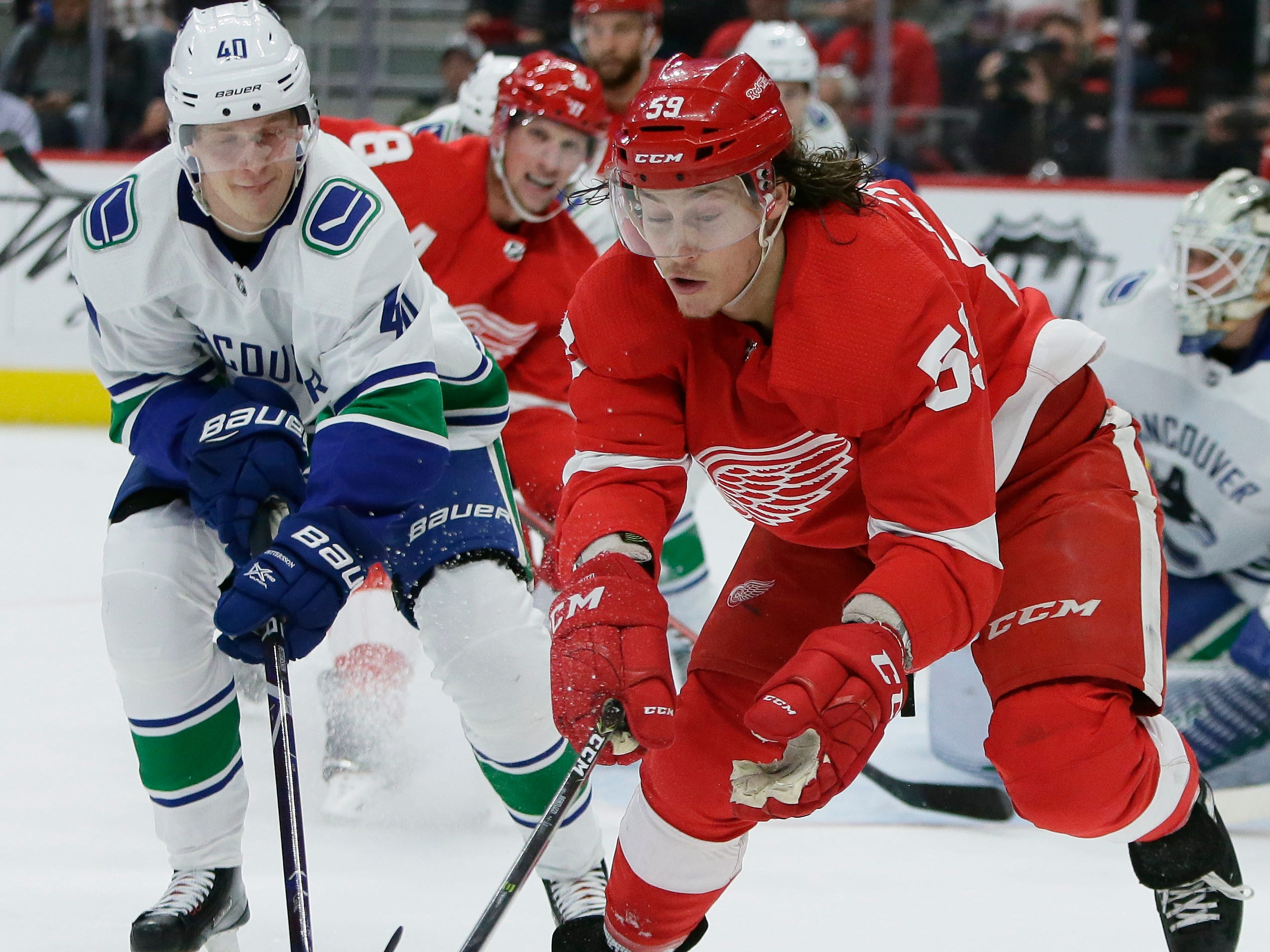 Detroit Red Wings left wing Tyler Bertuzzi (59) beats Vancouver Canucks center Elias Pettersson (40), of Sweden, to the puck during the second period of an NHL hockey game Tuesday, Nov. 6, 2018, in Detroit.