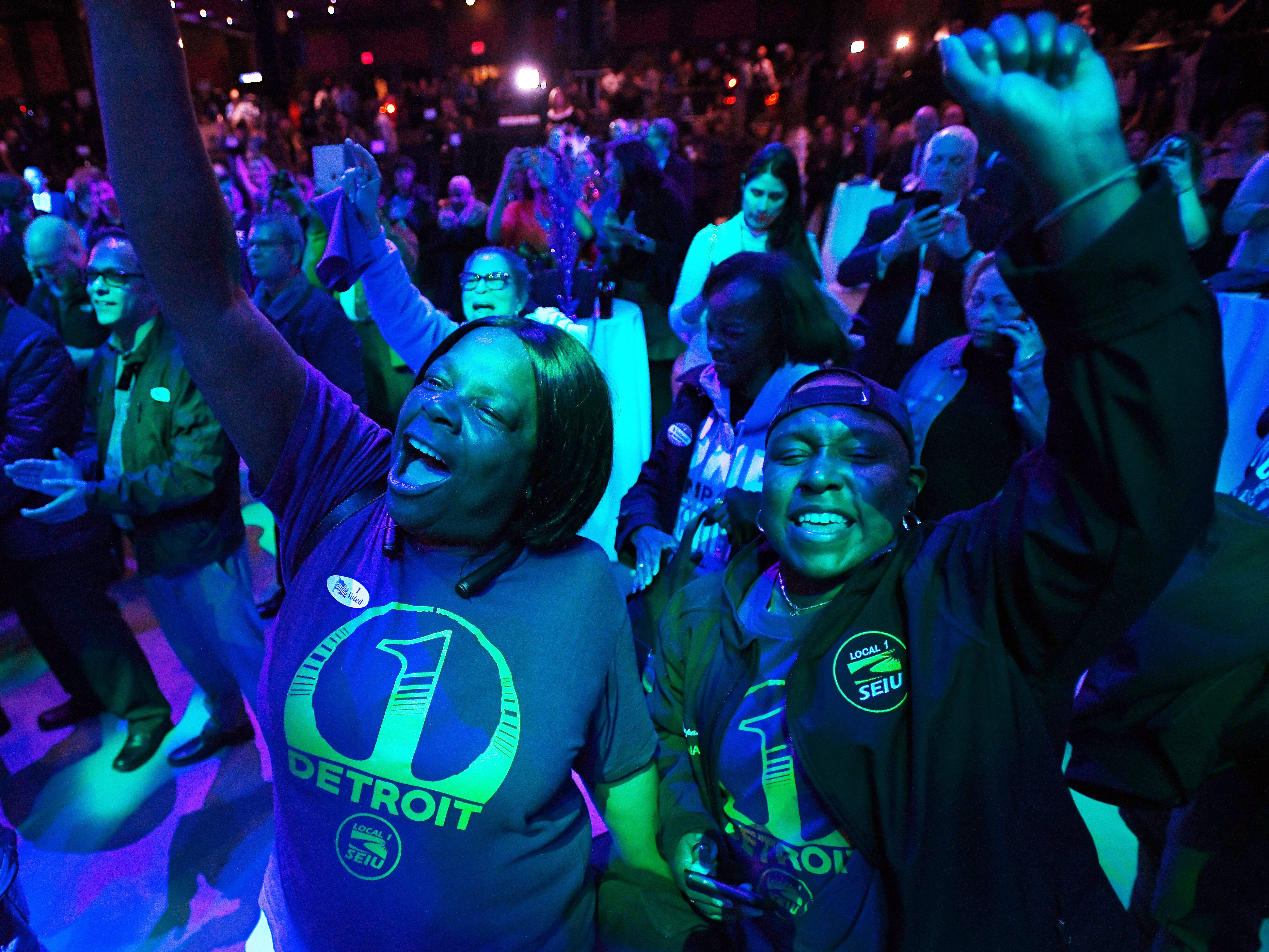 Kim Williams and Paulette Compass, both with SEIU, cheer as Detroit Mayor Mike Duggan tells the Democratic crowd at MotorCity Casino's Sound Board that  Michigan gubernatorial candidate Gretchen Whitmer is in the lead in the early results.