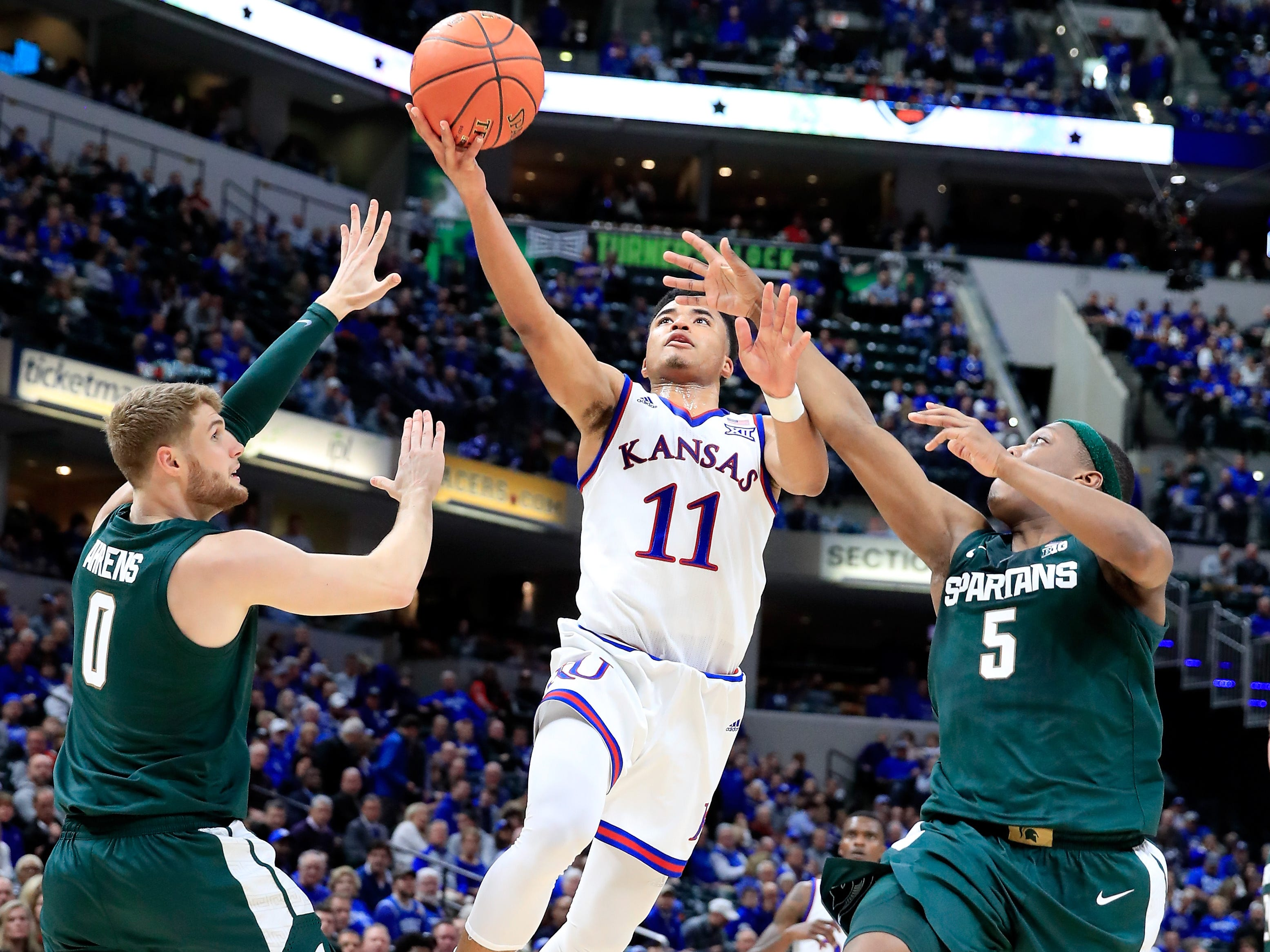 Devon Dotson (11) of the Kansas Jayhawks shoots the ball against the Michigan State Spartans during the State Farm Champions Classic at Bankers Life Fieldhouse on November 6, 2018 in Indianapolis, Indiana.