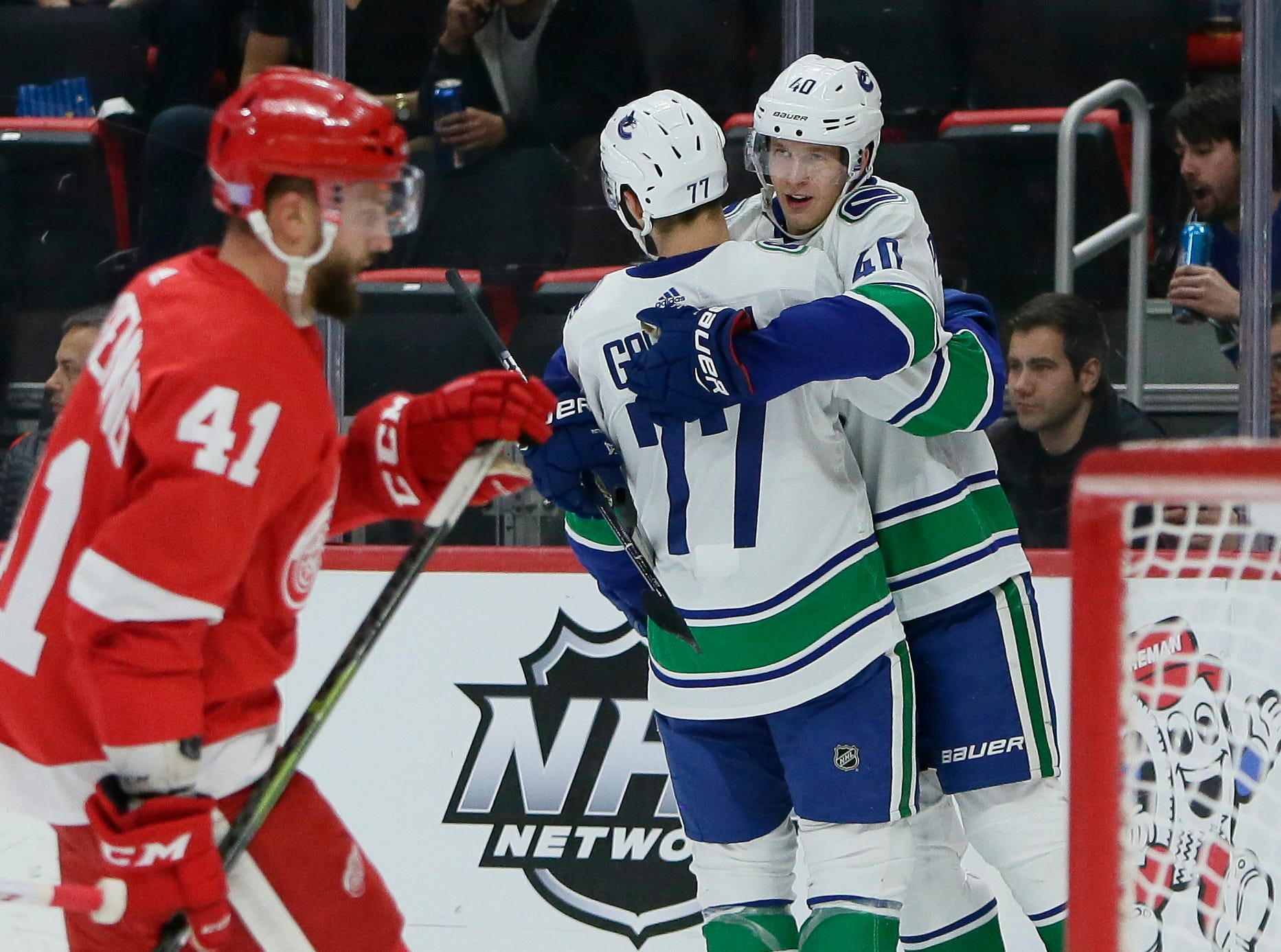 Vancouver Canucks center Elias Pettersson (40), of Sweden, celebrates his first period goal with right wing Nikolay Goldobin (77), of Russia, as Detroit Red Wings center Luke Glendening (41) skates away during an NHL hockey game Tuesday, Nov. 6, 2018, in Detroit.