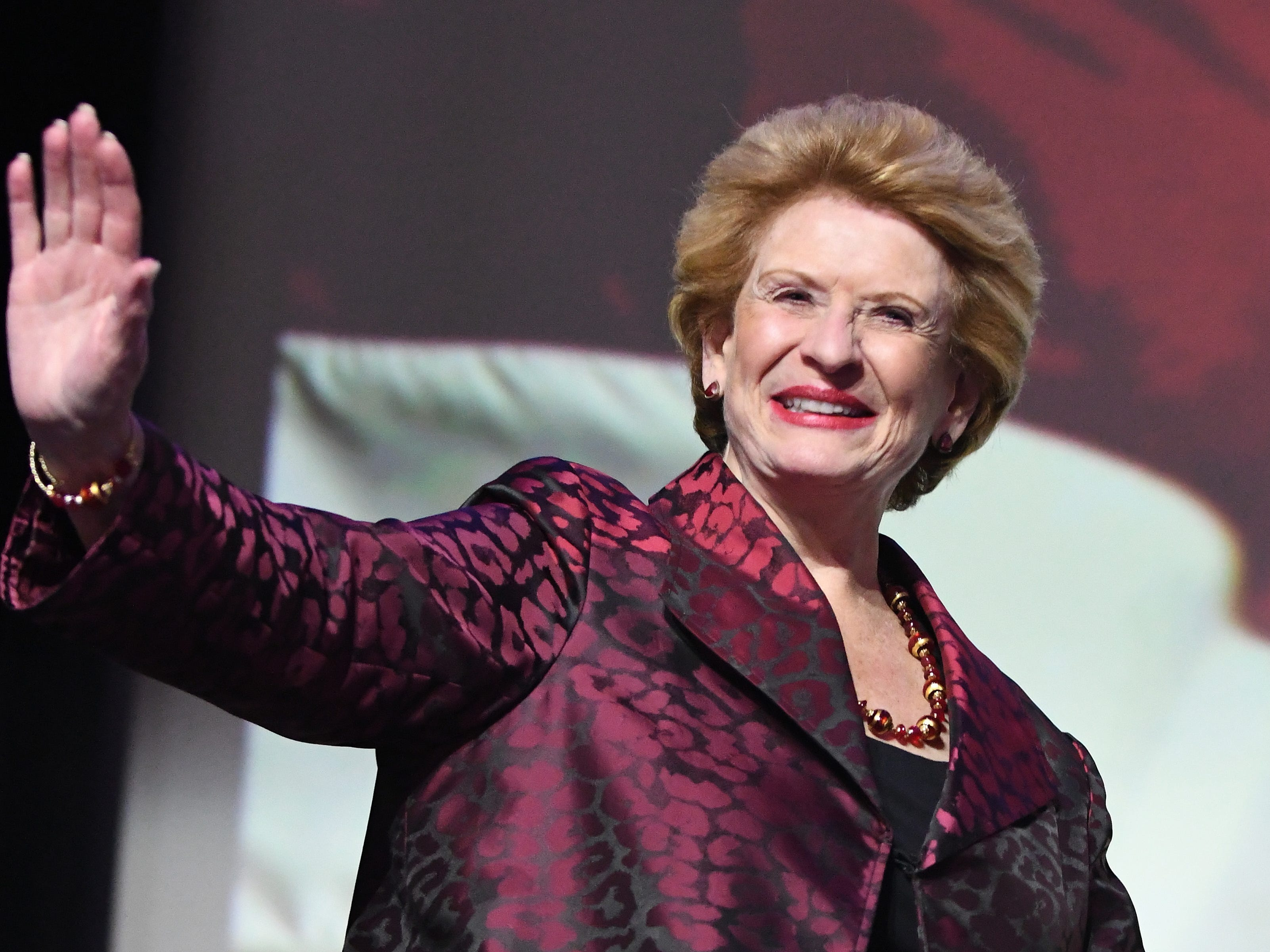 U.S. Senator Debbie Stabenow makes her way on stage after winning her race against John James. She joined  Democratic Party candidates at the Sound Board theater in the MotorCity Casino in Detroit Tuesday night.