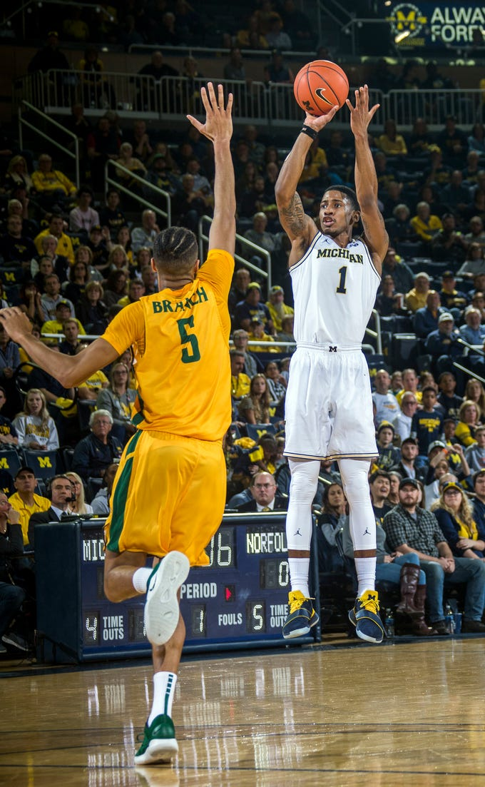Norfolk State forward Armani Branch (5) defends a three point attempt from Michigan guard Charles Matthews (1) in the first half of an NCAA college basketball game at Crisler Center in Ann Arbor, Mich., Tuesday, Nov. 6, 2018.