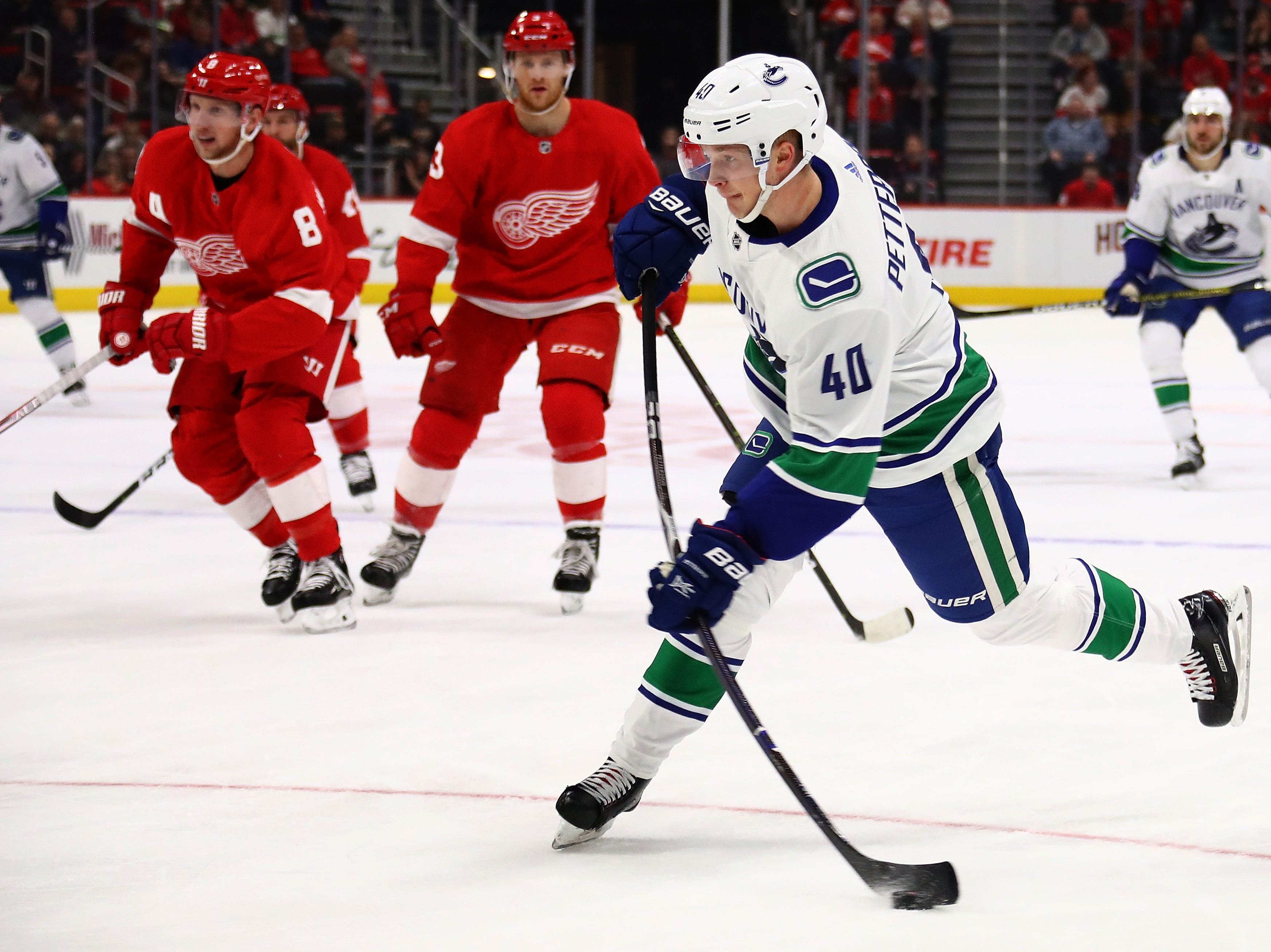 Elias Pettersson (40) of the Vancouver Canucks scores on a shot in the first period while playing the Detroit Red Wings at Little Caesars Arena.