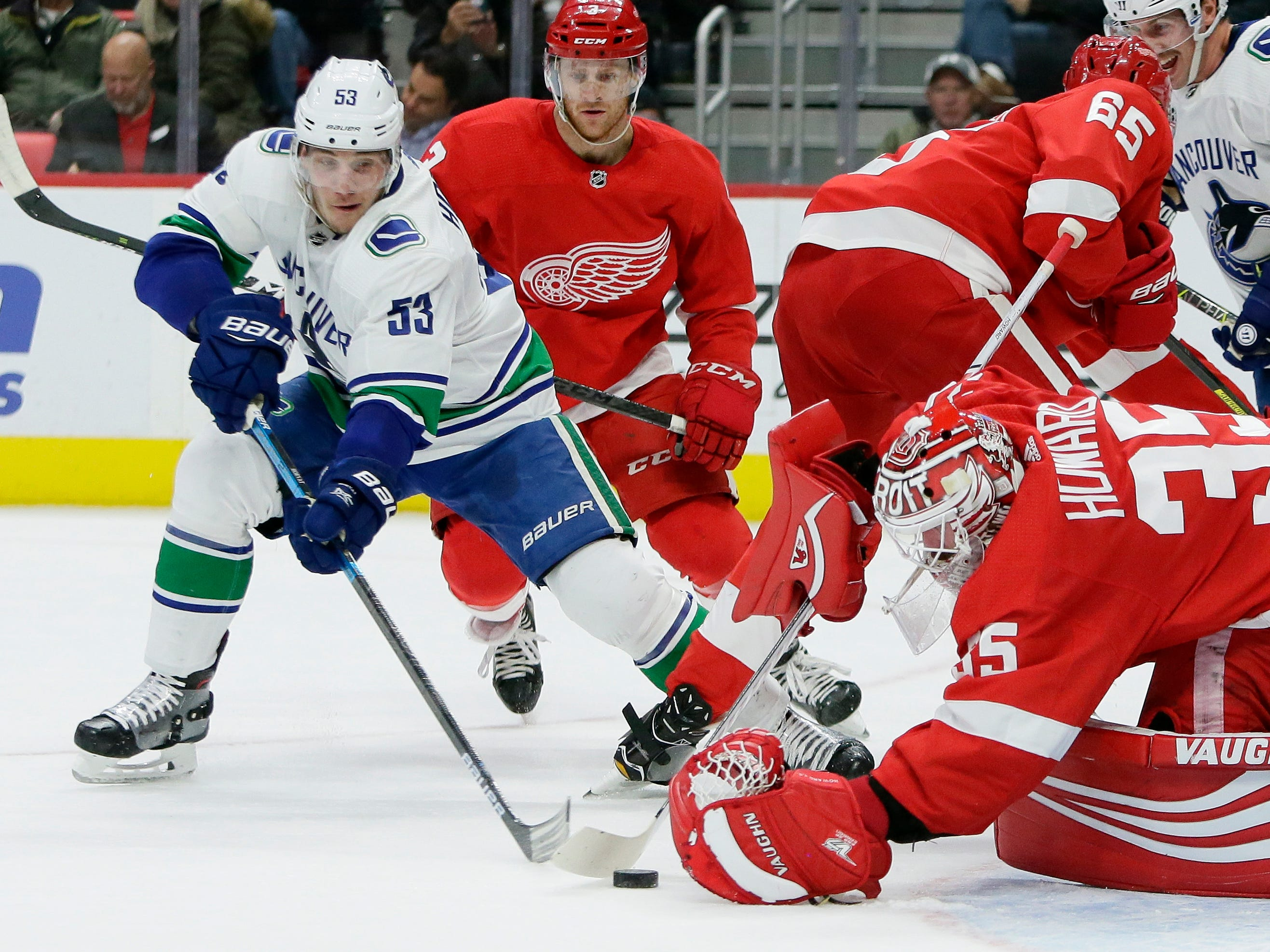 Detroit Red Wings goaltender Jimmy Howard (35) stops a shot by Vancouver Canucks center Bo Horvat (53) during the first period of an NHL hockey game Tuesday, Nov. 6, 2018, in Detroit.