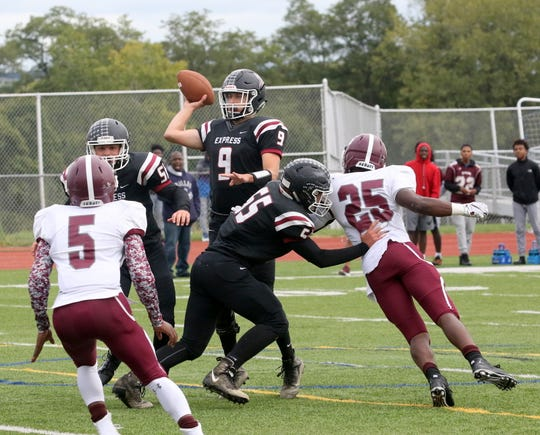 Elmira quarterback Zack Middaugh throws the ball during a 30-8 win over Syracuse Corcoran on Sept. 22, 2018 at Ernie Davis Academy.