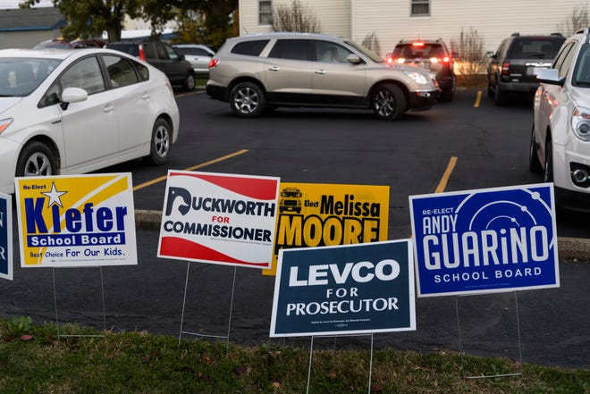 Candidate signs are displayed in front of St. Lucas United Church of Christ in Evansville, Ind., Tuesday evening Nov. 6, 2018. The church was one of 22 voting centers set up around Vanderburgh County.