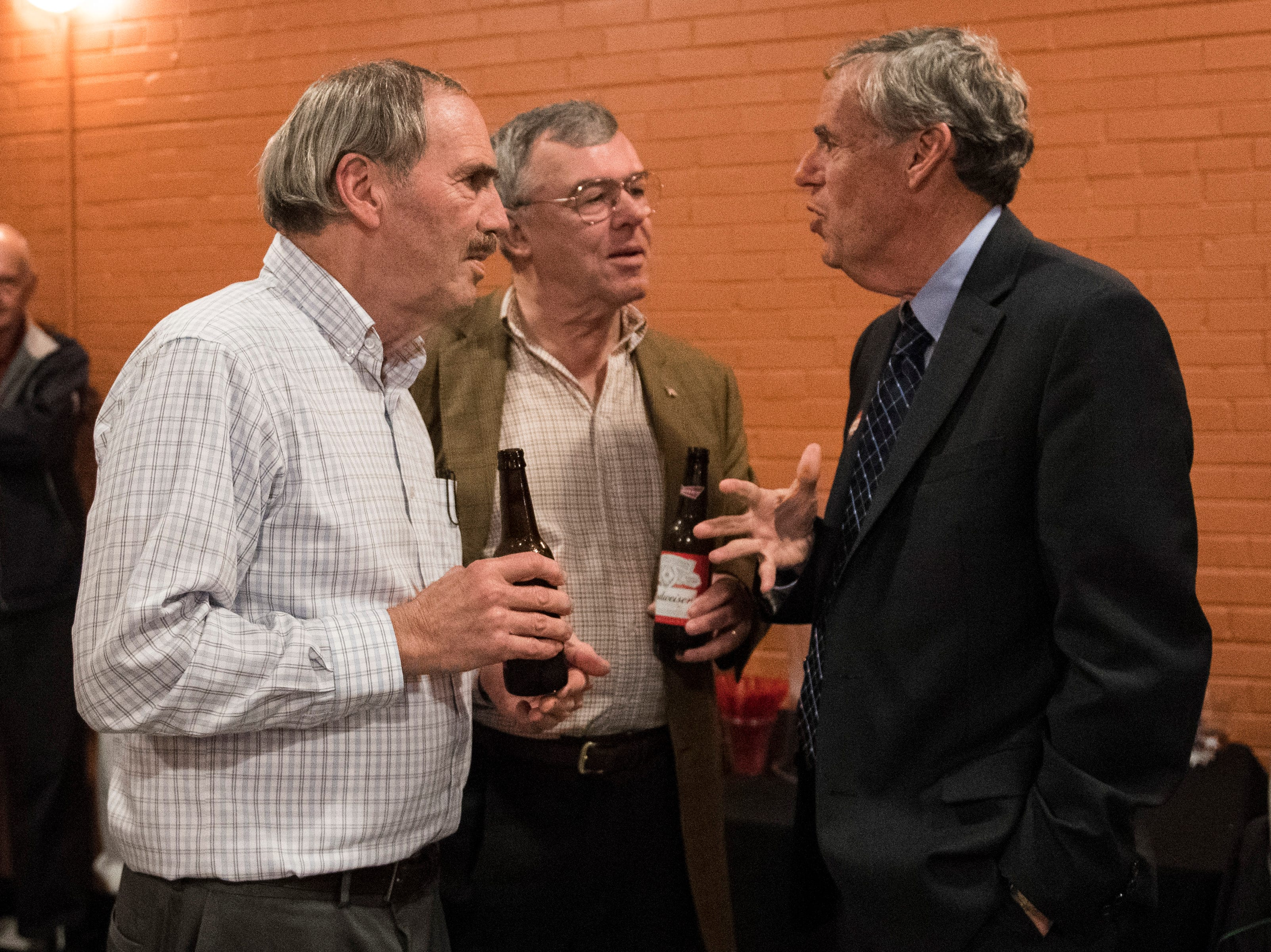 Stan Levco chats with college friends Bob Gaudet, left, and Jim Collins, middle, while attending the Vanderburgh County Democratic watch party held at DiLegge's Restaurant Tuesday Nov. 6, 2018.