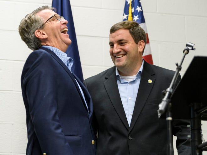Mayor Lloyd Winnecke, left, and Prosecutor Nick Hermann laugh together before addressing the crowd during the Republican watch party held at C K Newsome Community Center in Evansville, Ind., Tuesday, Nov. 6, 2018. Hermann defeated Democrat Stan Levco and will serve as the Vanderburgh County Prosecutor for the third time.