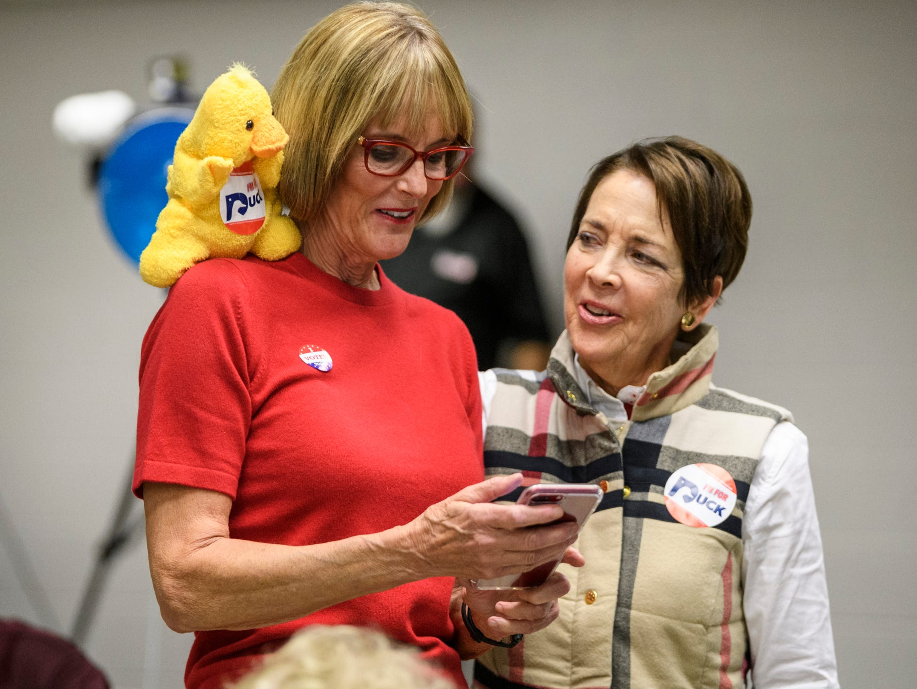 Lt. Governor Suzanne Crouch, left, prepares to take a photograph with Carolyn McClintock, right, and a duck puppet decorated with a Mike Duckworth campaign sticker during an election party held at C K Newsome Community Center in Evansville, Ind., Tuesday, Nov. 6, 2018. Duckworth lost the Vanderburgh County Commissioners seat to Democrat Jeff Hatfield by only 219 votes.