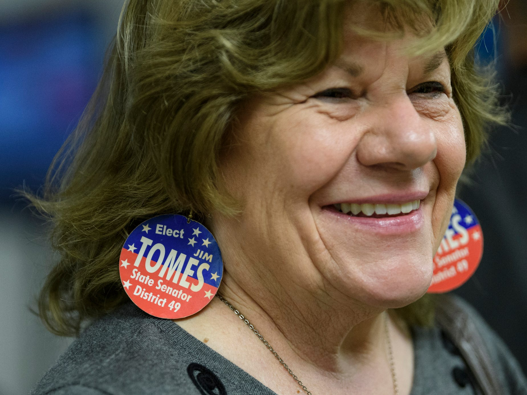 Margie Tomes wears earrings in support of her husband Jim Tomes' State Senate campaign while passing out stickers during the republican watch party at the C K Newsome Community Center in Evansville, Ind., Tuesday, Nov. 6, 2018. Jim defeated Democrat Edie Hardcastle in a landslide to keep his spot on the state senate.