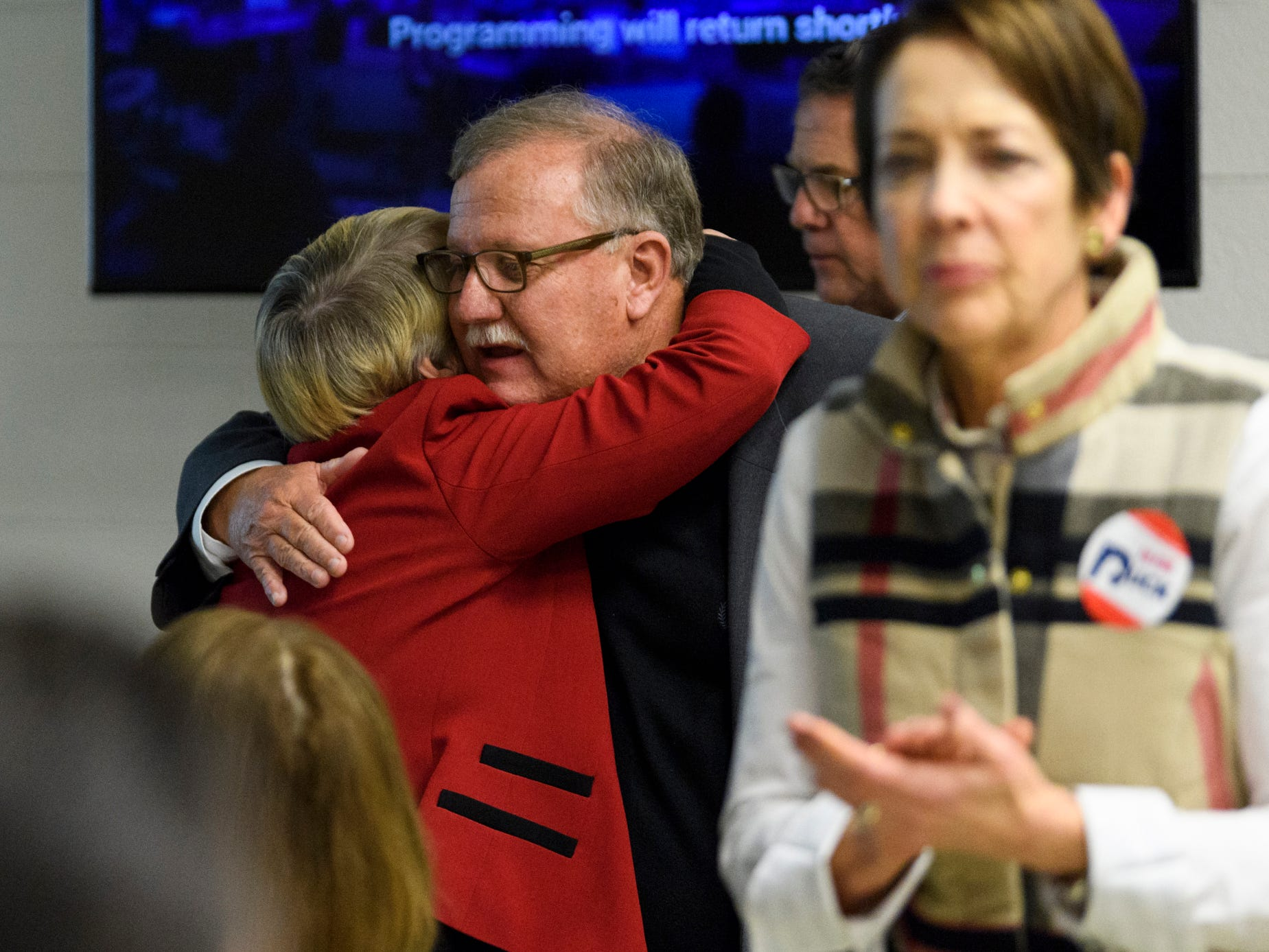 Mike Duckworth, center, is embraced after giving his concession speech to the Republican watch party at the C K Newsome Community Center in Evansville, Ind., Tuesday, Nov. 6, 2018. He lost the Vanderburgh County Commissioners seat to Democrat Jeff Hatfield by only 219 votes.
