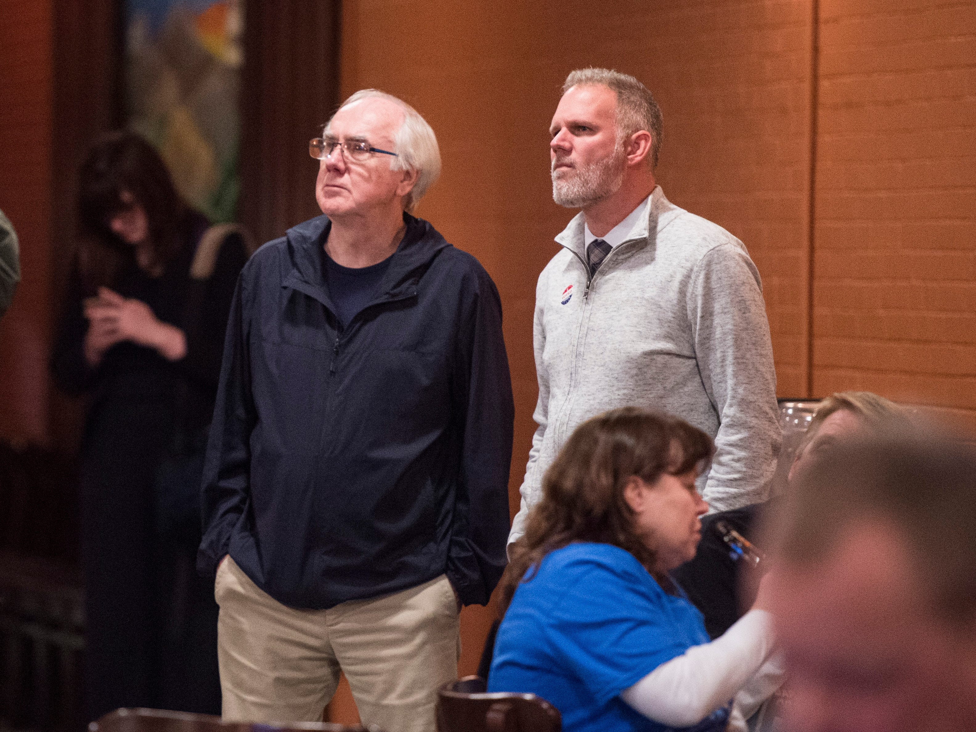 Dennis Avery, left, and Zachary Heronemus stare at the tv as the 2018 midterm elections results come in while attending the Vanderburgh County Democratic watch party held at DiLegge's Restaurant Tuesday Nov. 6, 2018.