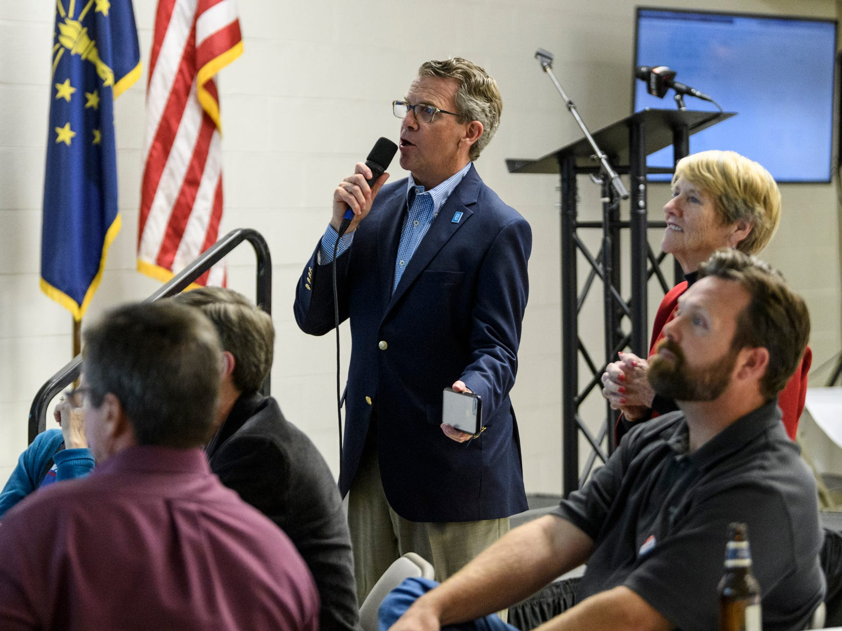 Mayor Lloyd Winnecke, top center, reads out results during the Republican watch party held at C K Newsome Community Center in Evansville, Ind., Tuesday, Nov. 6, 2018.