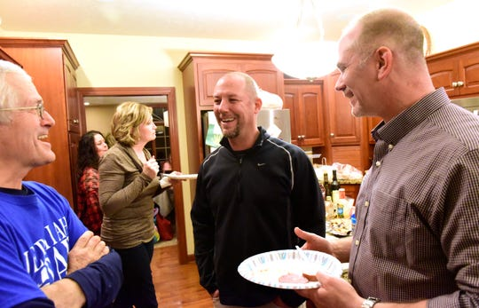 Jeremiah Ray, middle, attending an Election Night party in Bellevue, won election as Sandusky County Common Pleas Court judge.