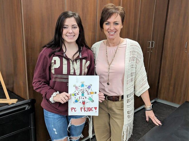 Bataan Memorial Primary Principal Kendra Van Doren stands with Principal's Club T-shirt design winner Isabella Fillmore.