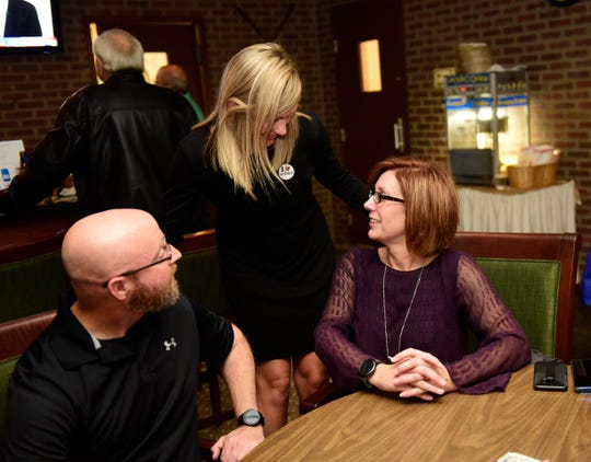 Beth Tischler, right, talking with well-wishers at Fremont Country Club on Tuesday night, was unsuccessful in her bid for Sandusky County District 1 judge.