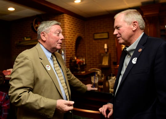 Russ Zimmerman, left, the Republican winner in the race for Sandusky County Commissioner, talks with Bill Reineke, Republican incumbent who won re-election to Ohio House 88th District seat, at Fremont Country Club on Tuesday night.