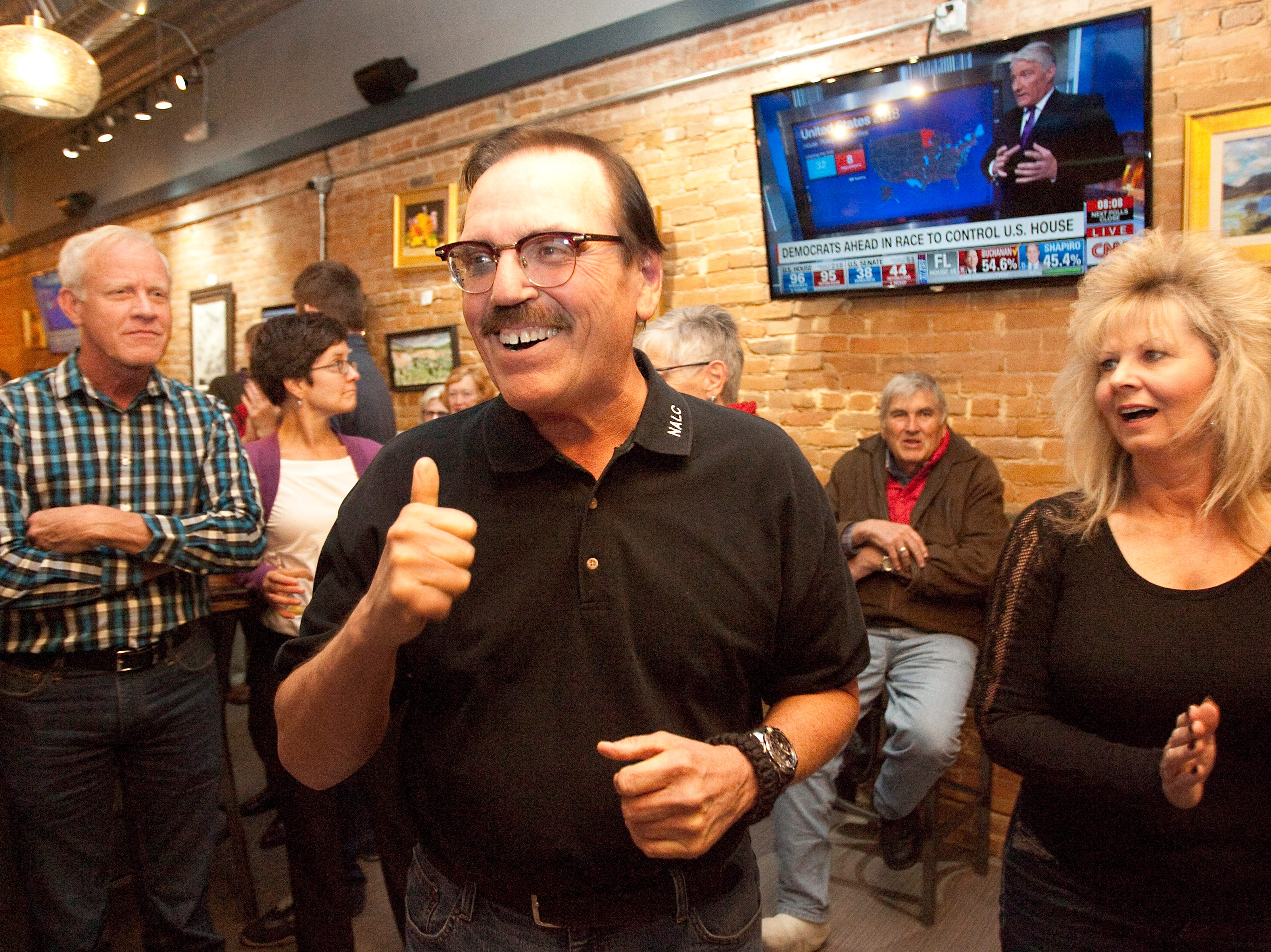 Gil Barela, campaign manager for ballot issue 1A, gives a thumbs up after hearing the early results for the Larimer County ballot issue 1A during a watch party held at the Loveland TapHouse Tuesday evening.