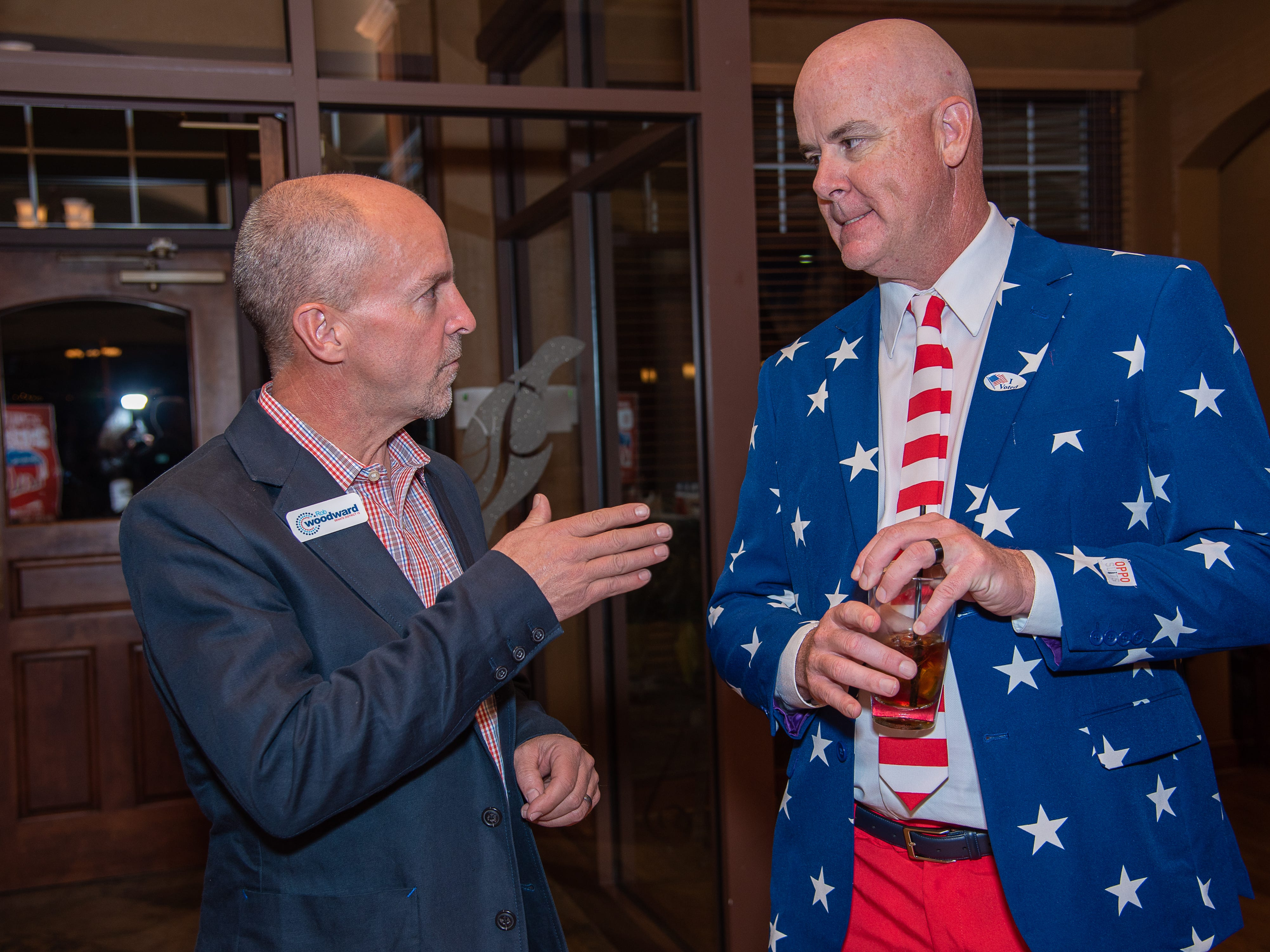 GOP Senate District 15 candidate Rob Woodward speaks with supporter David Powell  during an election watch party on November 6, 2018, at Ptarmigan Country Club in Fort Collins, Colo.