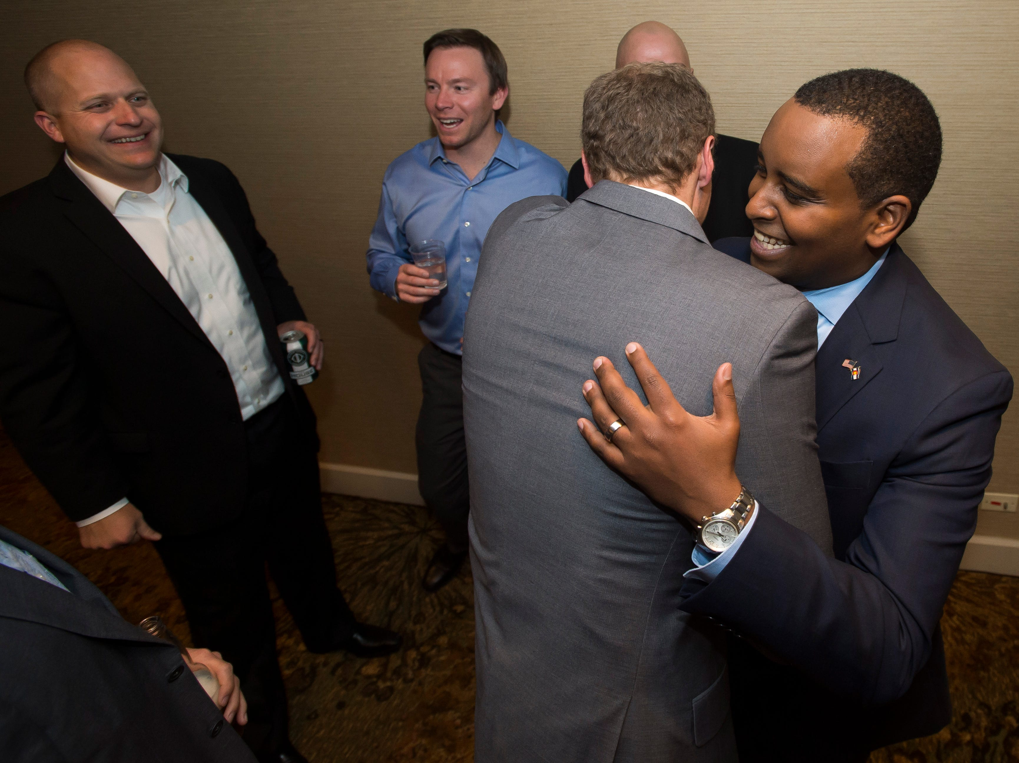 Colorado 2nd congressional district candidate Joe Neguse is congratulated by friends during his election watch party on Tuesday, Nov. 6, 2018, at the Westin Denver Downtown hotel in Denver, Colo.
