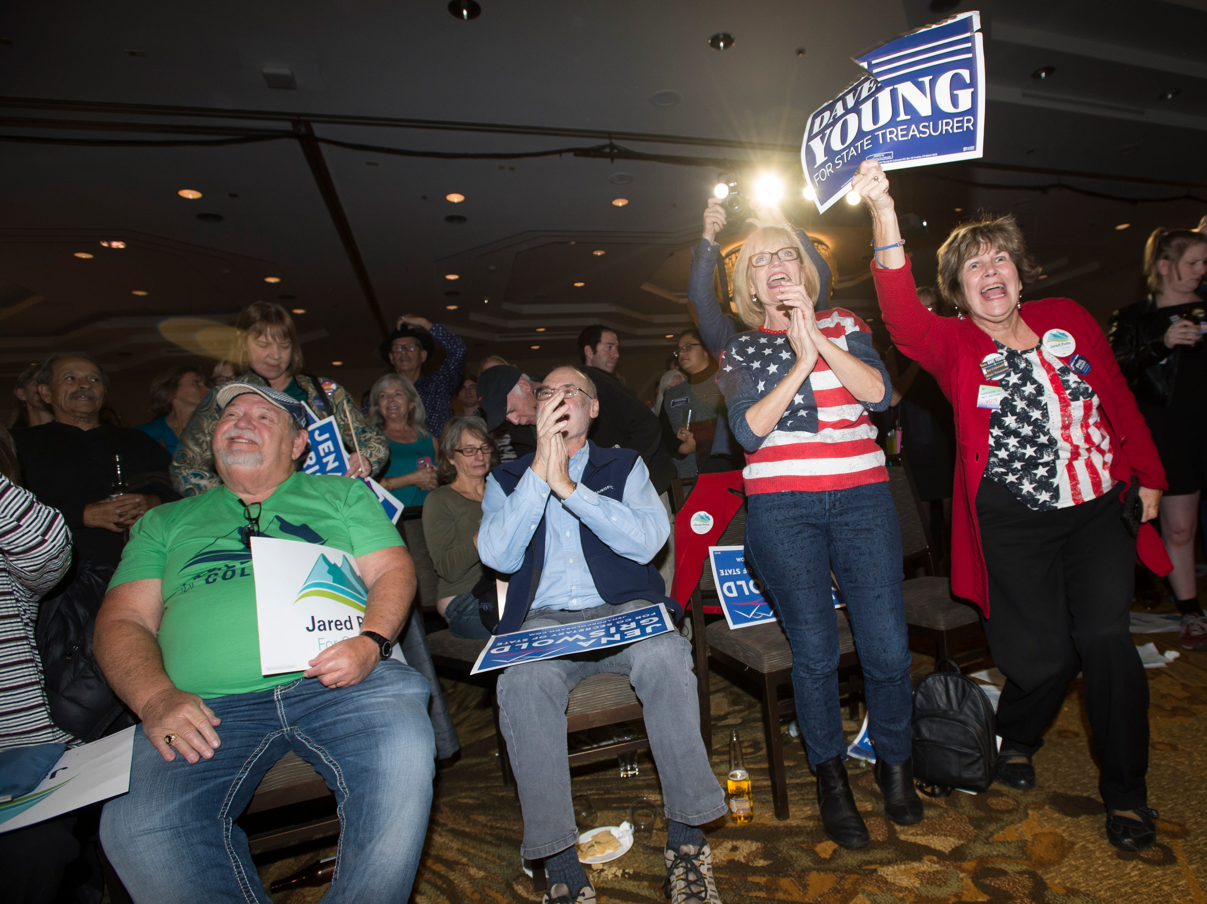 Audience members cheer as Democratic candidate for Colorado State Treasurer Dave Young speaks during an election watch party on Tuesday, Nov. 6, 2018, at the Westin Denver Downtown hotel in Denver, Colo.