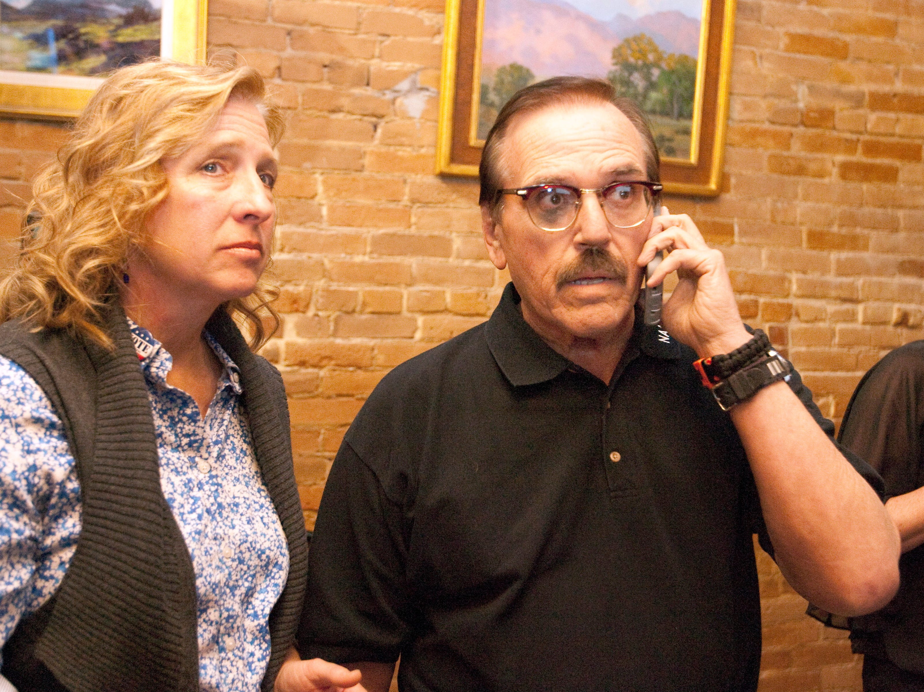Gil Barela, campaign manager for ballot issue 1A, waits on the phone hoping to get early results for the Larimer County ballot issue 1A, while Jody Shadduck­McNally, campaign treasurer, looks on during a watch party held at the Loveland TapHouse Tuesday evening.