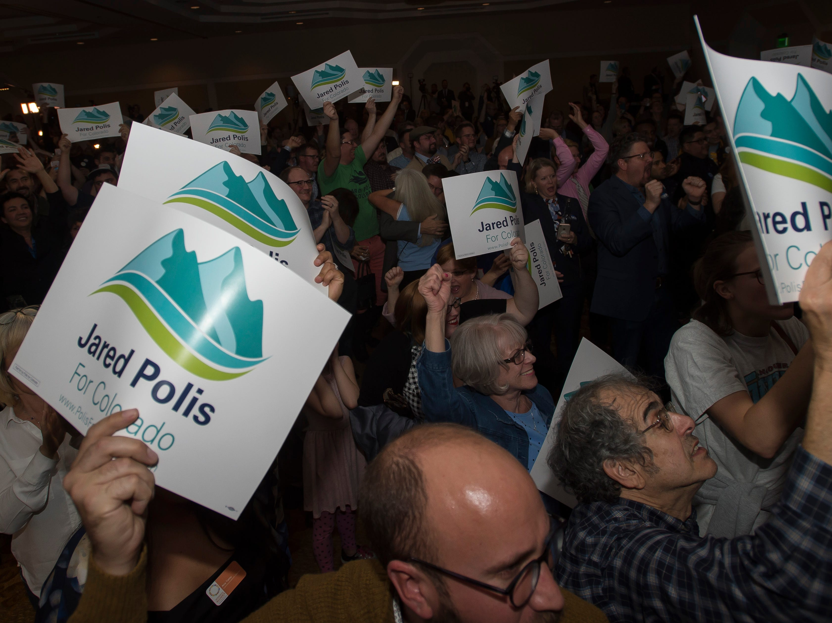 The crowd cheers as election results are broadcast during Democratic candidate for Colorado governor Jared Polis' election watch party on Tuesday, Nov. 6, 2018, at the Westin Denver Downtown hotel in Denver, Colo.