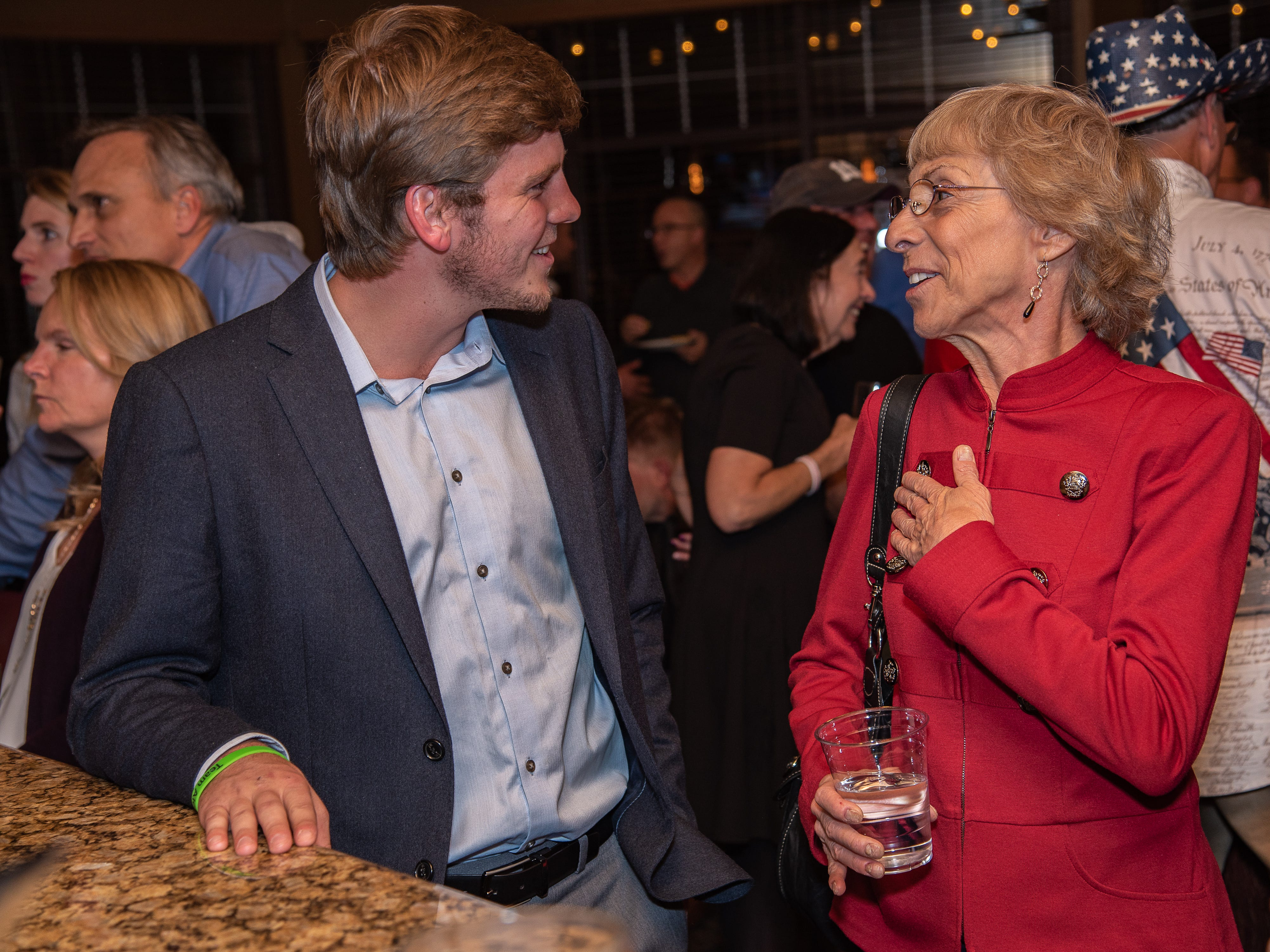 GOP House District 52 candidate Donna Walter speaks with Jack Brady, CSU student and GOP volunteer, at an election watch party on Tuesday, November 6, 2018, at Ptarmigan Country Club in Fort Collins, Colo.
