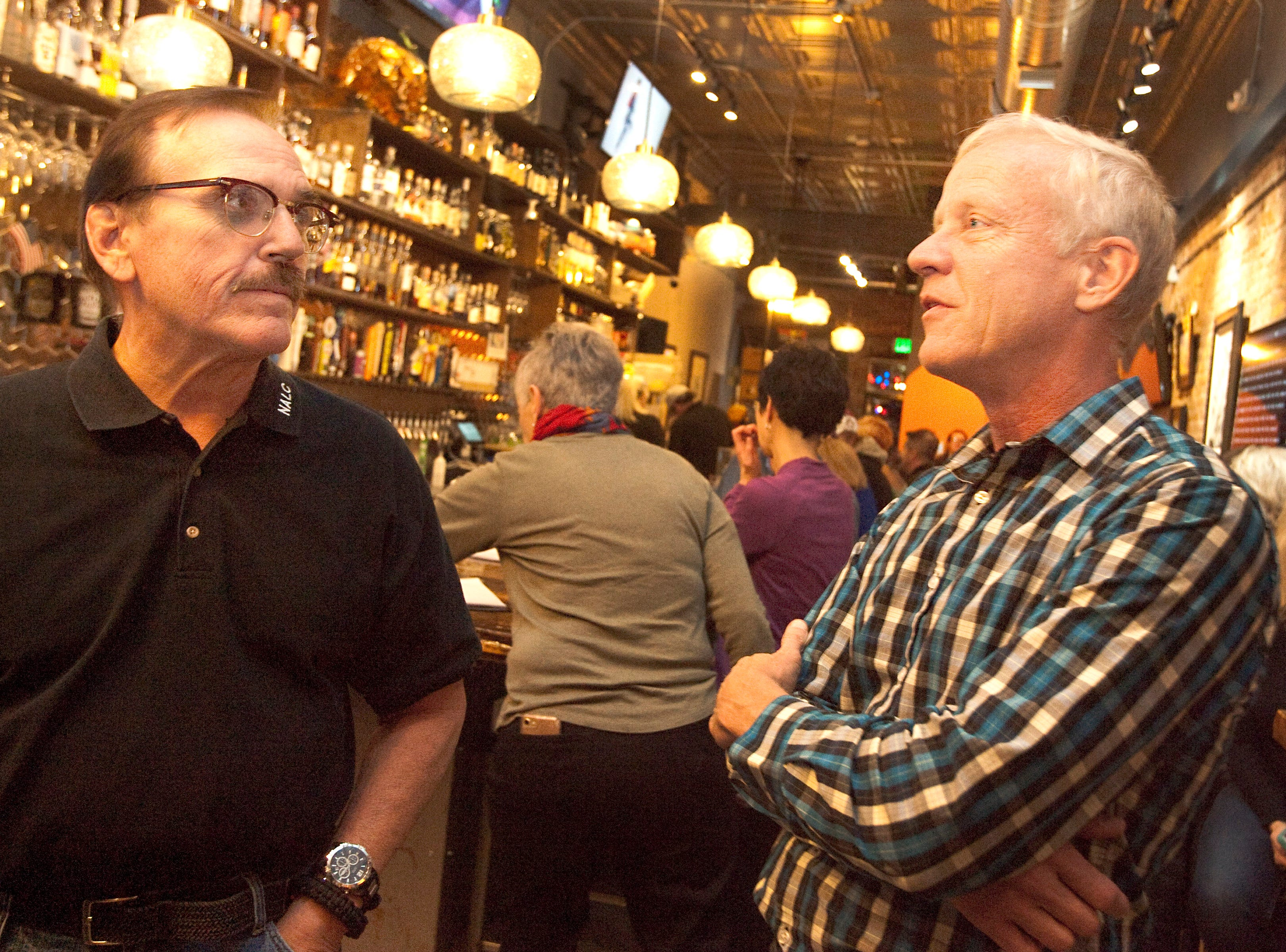 Gil Barela, left, campaign manager for ballot issue 1A, chats with Larimer County Commissioner Steve Johnson during a watch party held at the Loveland TapHouse Tuesday evening.