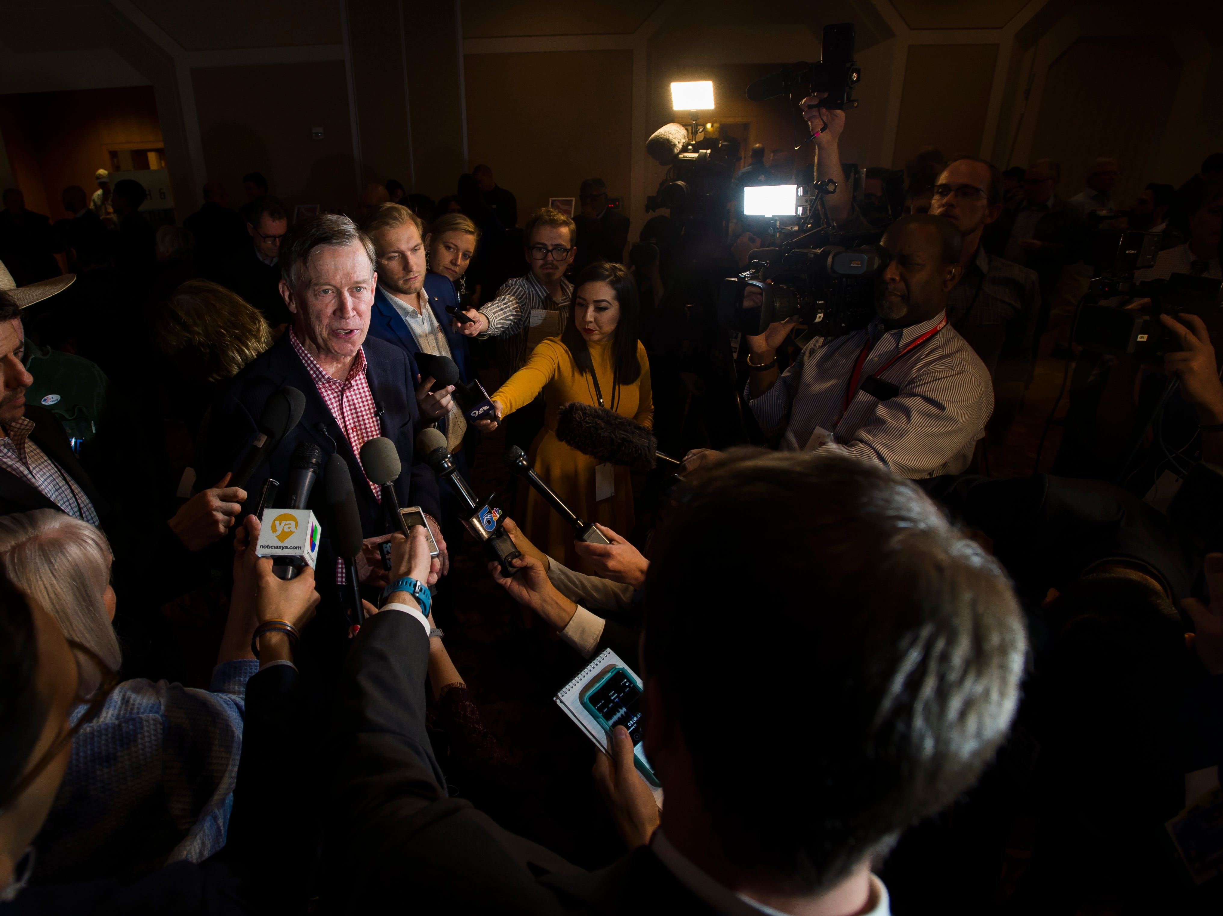 Colorado Governor John Hickenlooper speaks to members of the media before an election watch party for Democratic candidate for Colorado governor Jared Polis on Tuesday, Nov. 6, 2018, at the Westin Denver Downtown hotel in Denver, Colo.