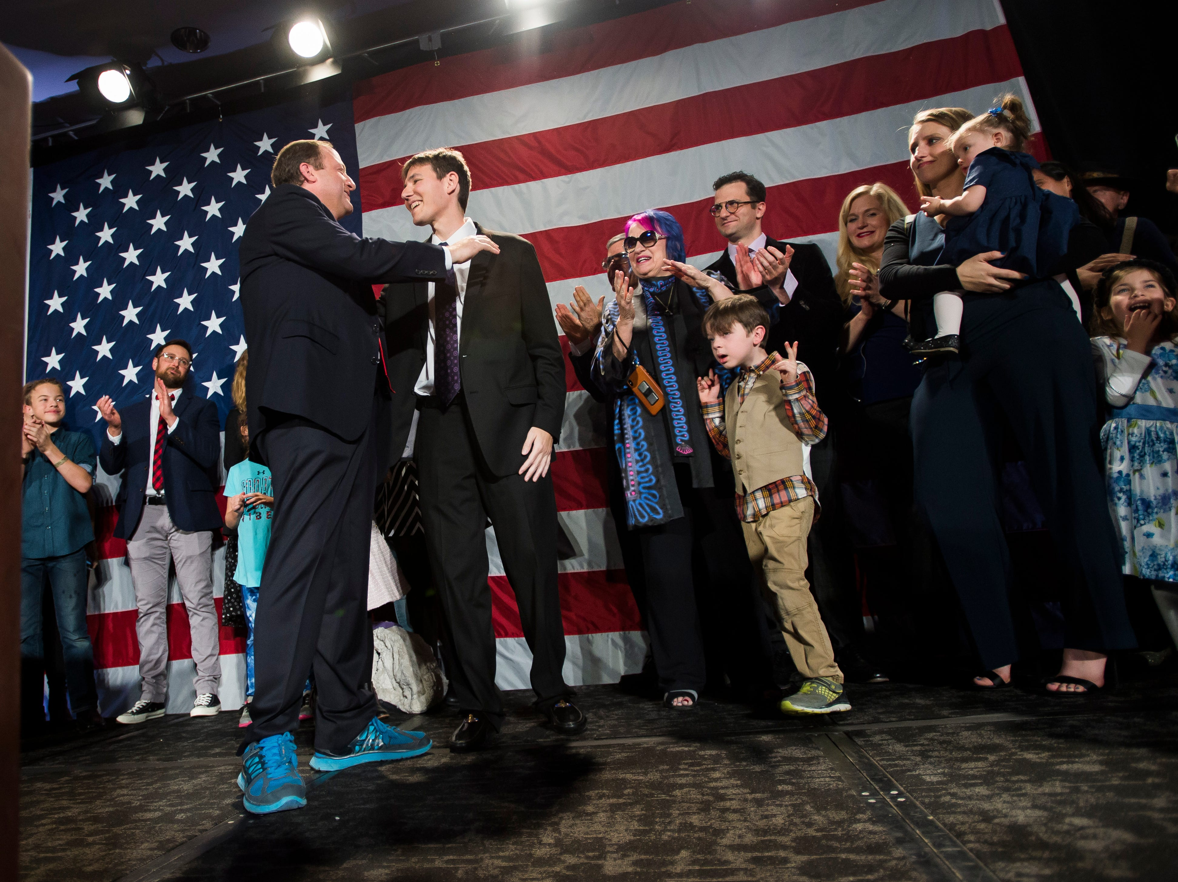Democratic candidate for Colorado governor Jared Polis hugs his partner Marlon Reis after Republican candidate Walker Stapleton conceded the race on Tuesday, Nov. 6, 2018, at the Westin Denver Downtown hotel in Denver, Colo.