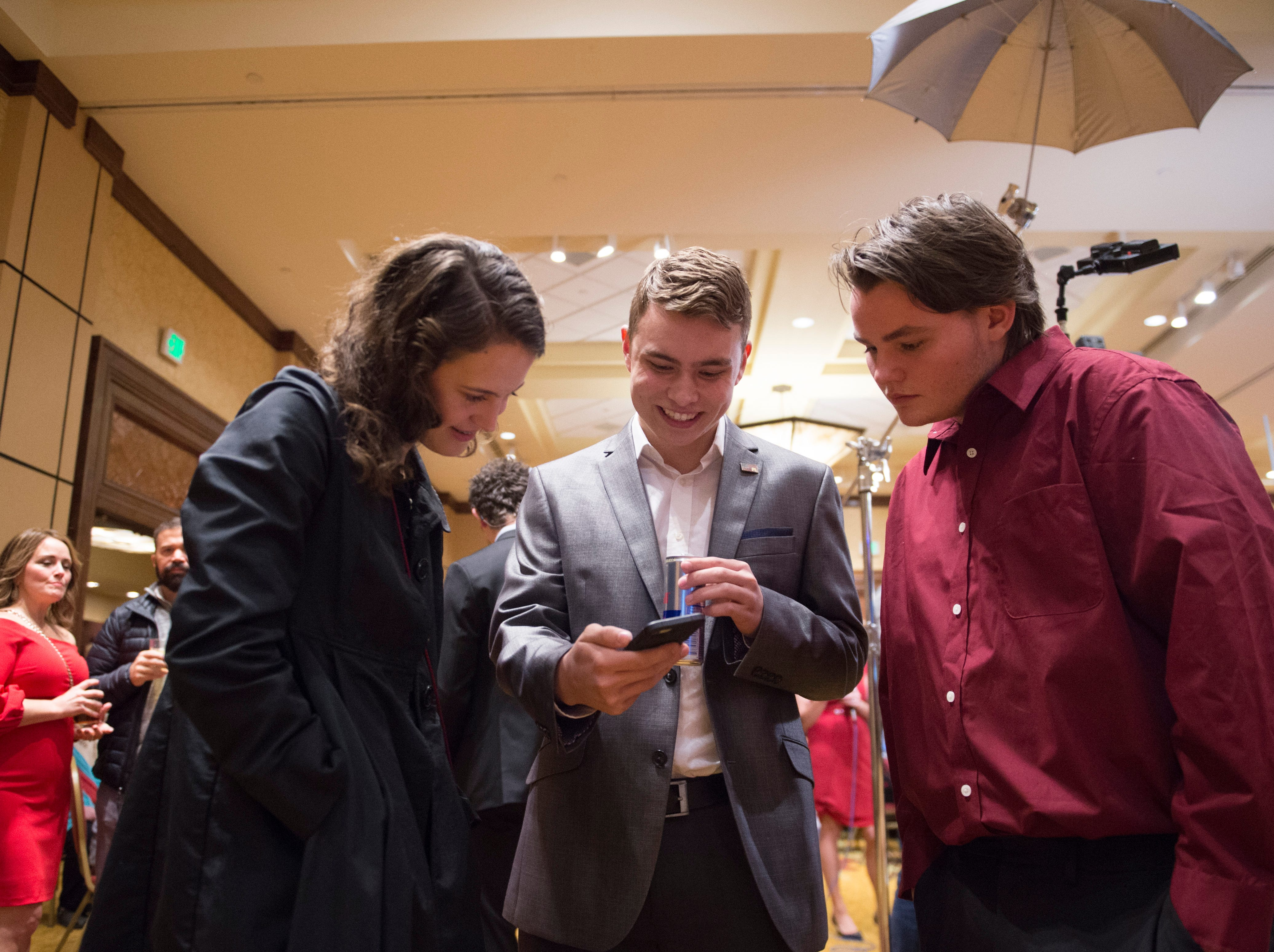 Sophia Schwarz, Aidan Duncan and Kameron Fischer look for election results during a Colorado GOP watch party at the Denver Marriott South at Park Meadows in Lone Tree on Election Day, Tuesday, November 6, 2018.