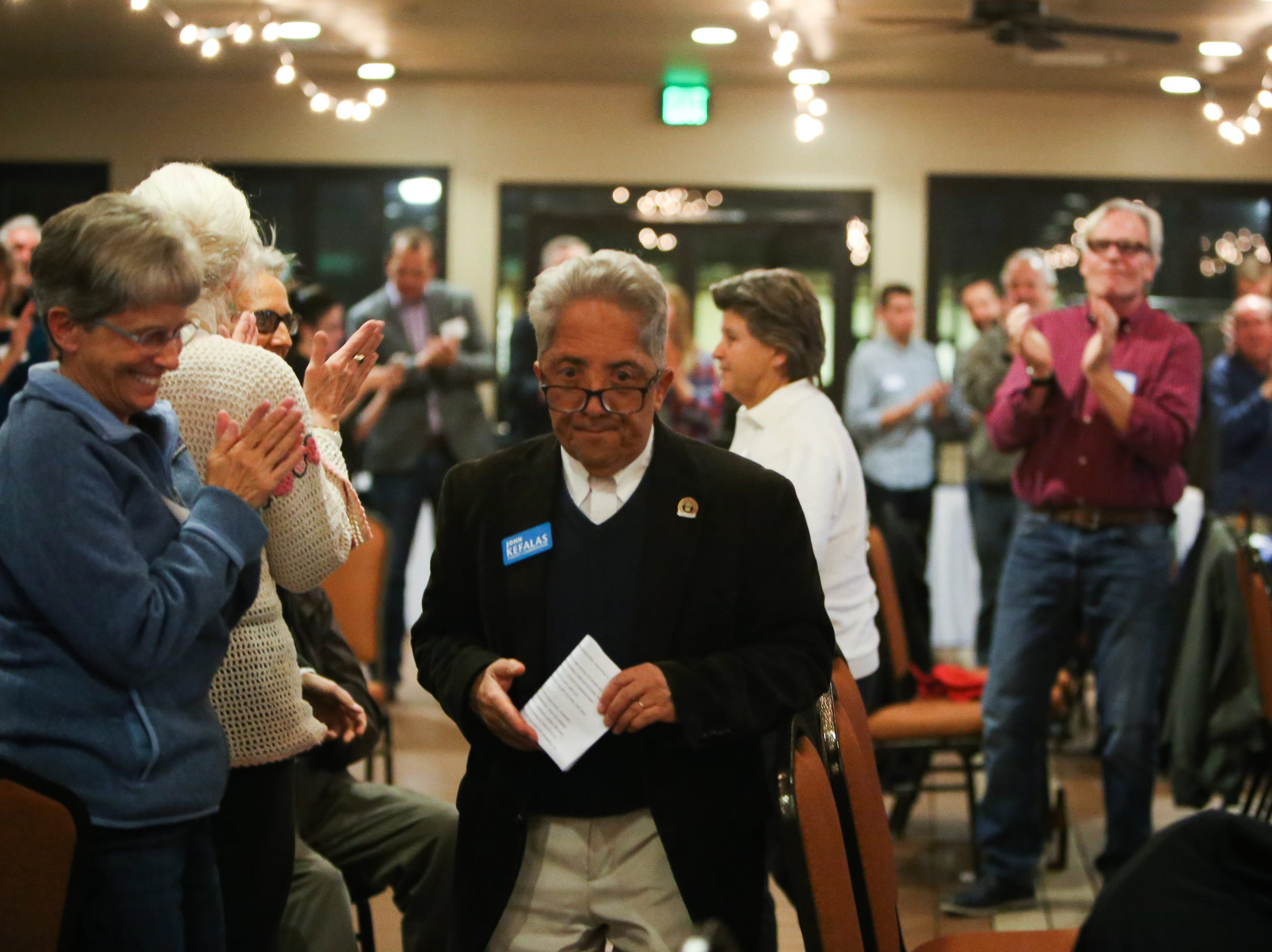 Sen. John Kefalas walks through a crowd of applause as he heads towards the stage to give his acceptance speech Tuesday evening at the Democrats' watch party at the Fort Collins Marriott.