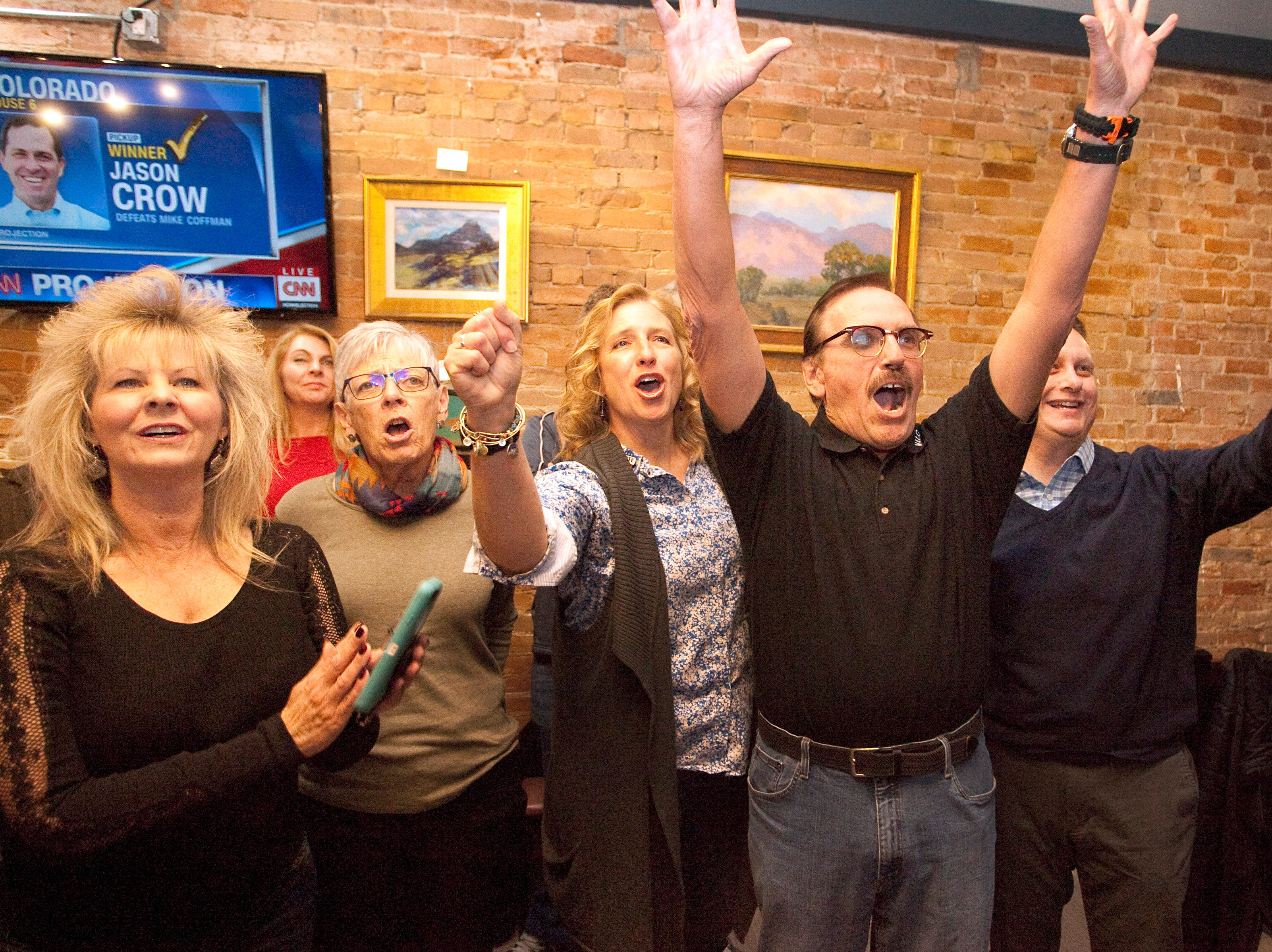 From left, Darla Barela, Diann Rice, Jody Shadduck­ McNally, Gil Barela and Michael Allen, CEO for SummittStone Health Partners, celebrate the early results for the Larimer County ballot issue 1A during a watch party held at the Loveland TapHouse on Tuesday evening.
