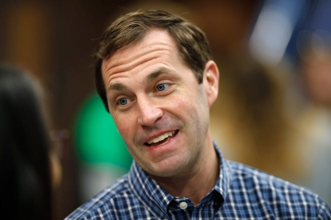 FILE - In this Saturday, Oct. 20, 2018, file photograph, Democratic candidate for U.S. House District 6, Jason Crow, greets canvassers as they head out to round up votes from Hinkley High School in Aurora, Colo. Crow is facing Republican incumbent Mike Coffman for the seat. (AP Photo/David Zalubowski, File)