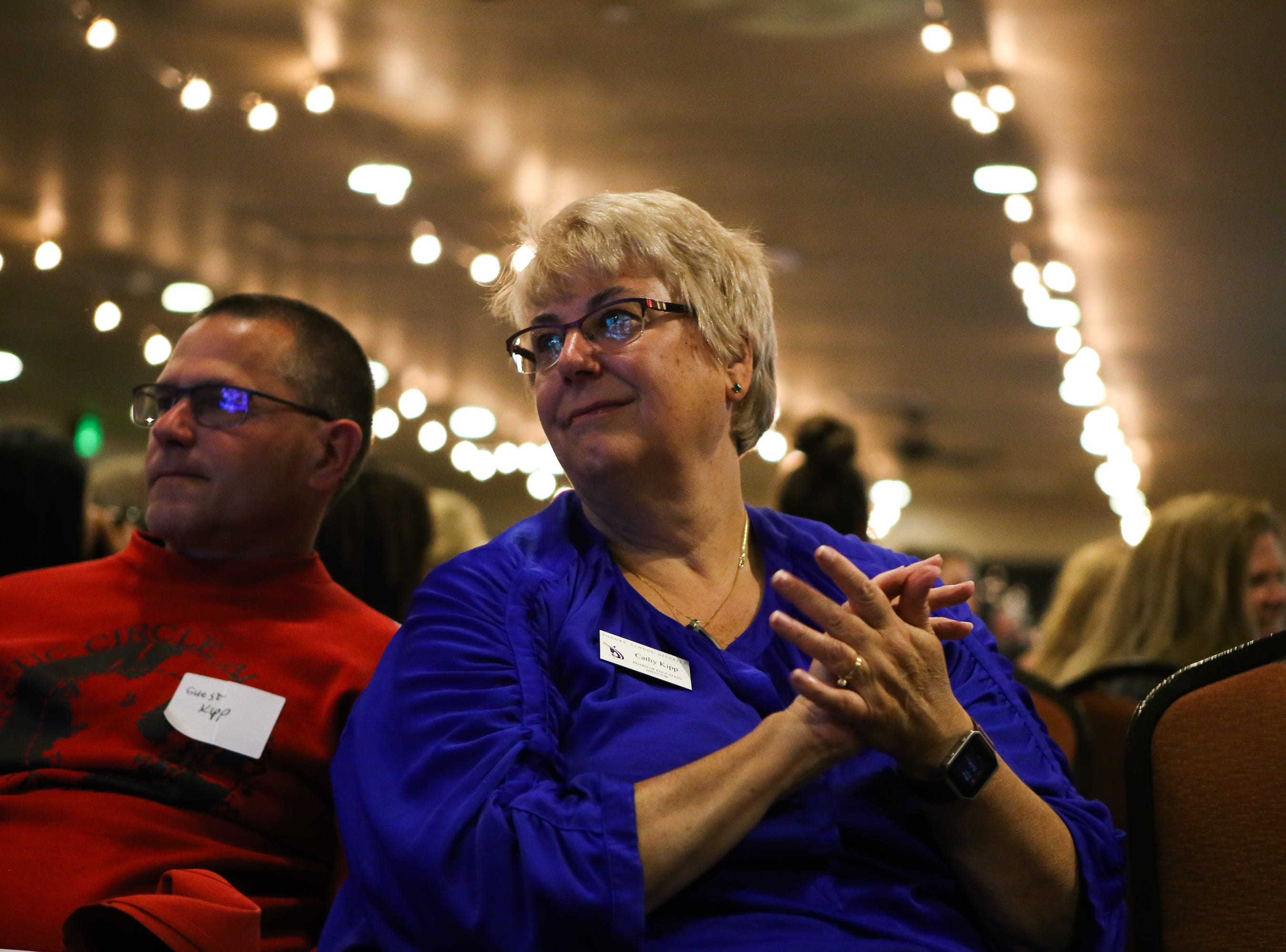 Poudre School Board member Cathy Kipp claps with the crowd at the Democrats' watch party at the Fort Collins Marriott after the speaker celebrates Jared Polis' win for the governor's seat.